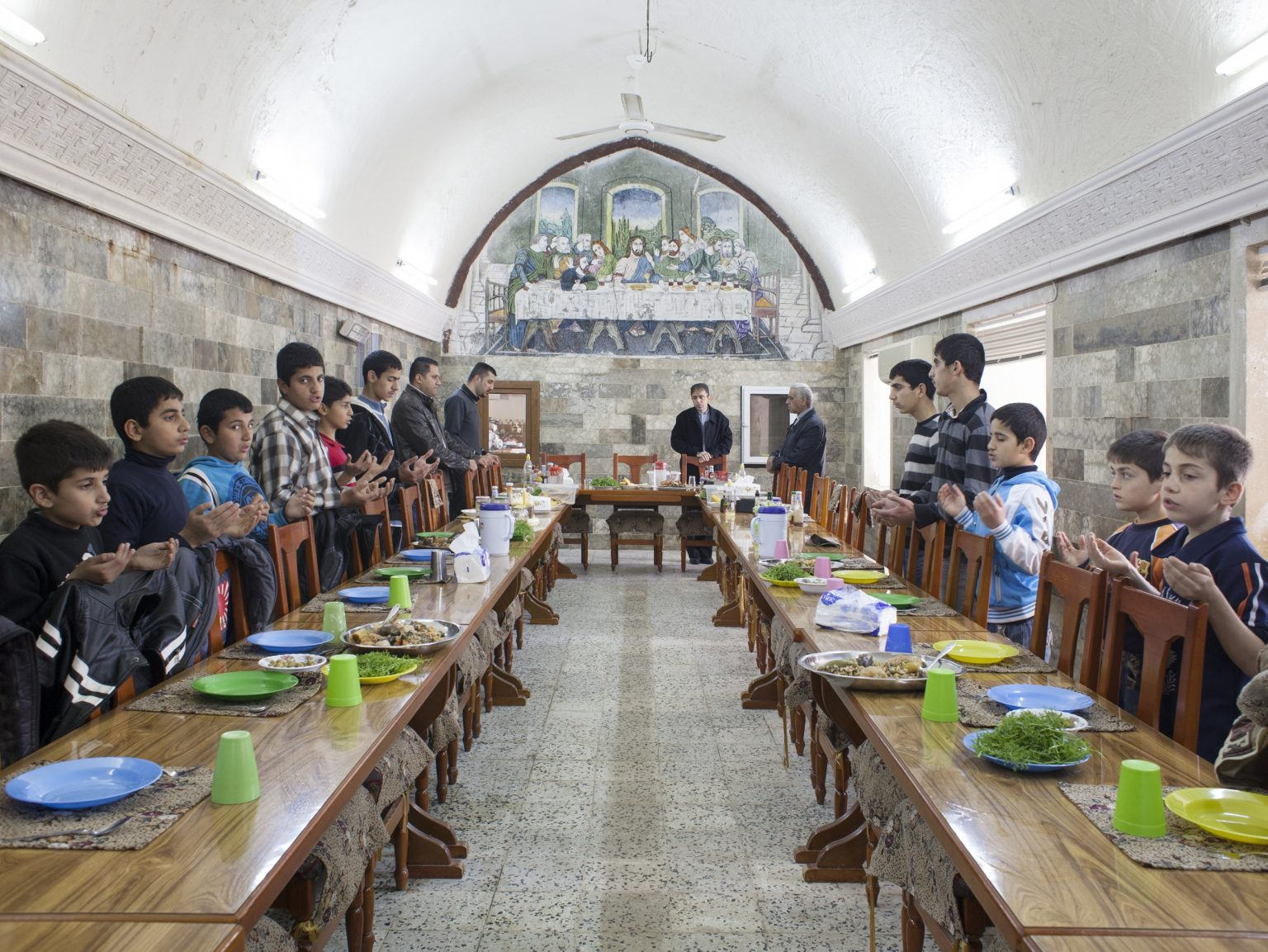 Children having lunch in the orphanage in the Monastery of the Virgin Mary in Al Qosh.  The orphanage was opened in 1949 and at the moment 19 boys between 4 and 16 years old are living in there.