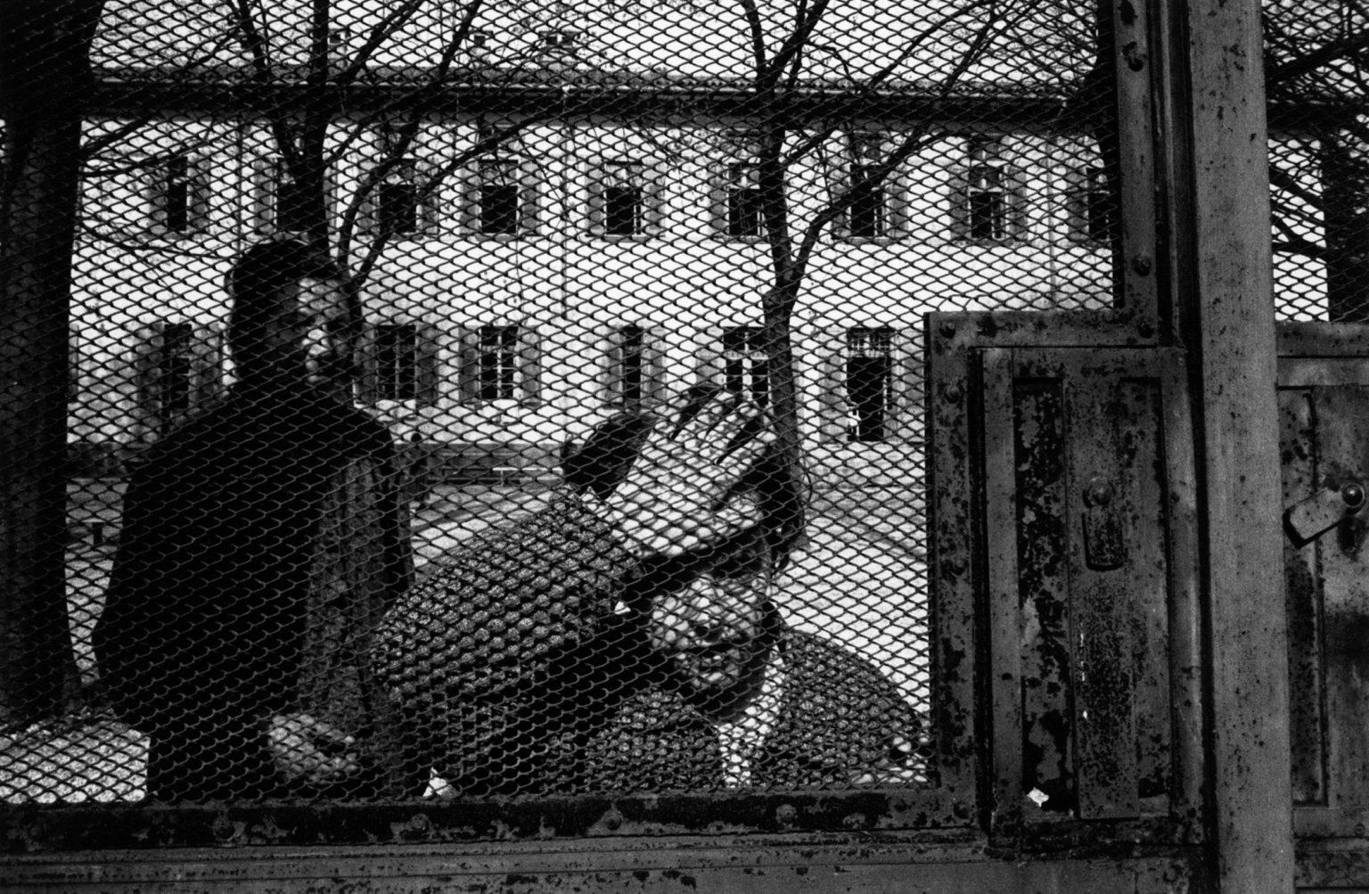 """Gorizia, 1968-1969 - Recreational time in the courtyard. A patient leaning on the grating before it being tear down. ><  Gorizia, 1968-1969 - Un momento di svago nel cortile. Una paziente si appoggia alla recinzione prima che questa venga abbattuta.<p><span style=""""color: #ff0000""""><strong>*** SPECIAL   FEE   APPLIES ***</strong></span></p>"""
