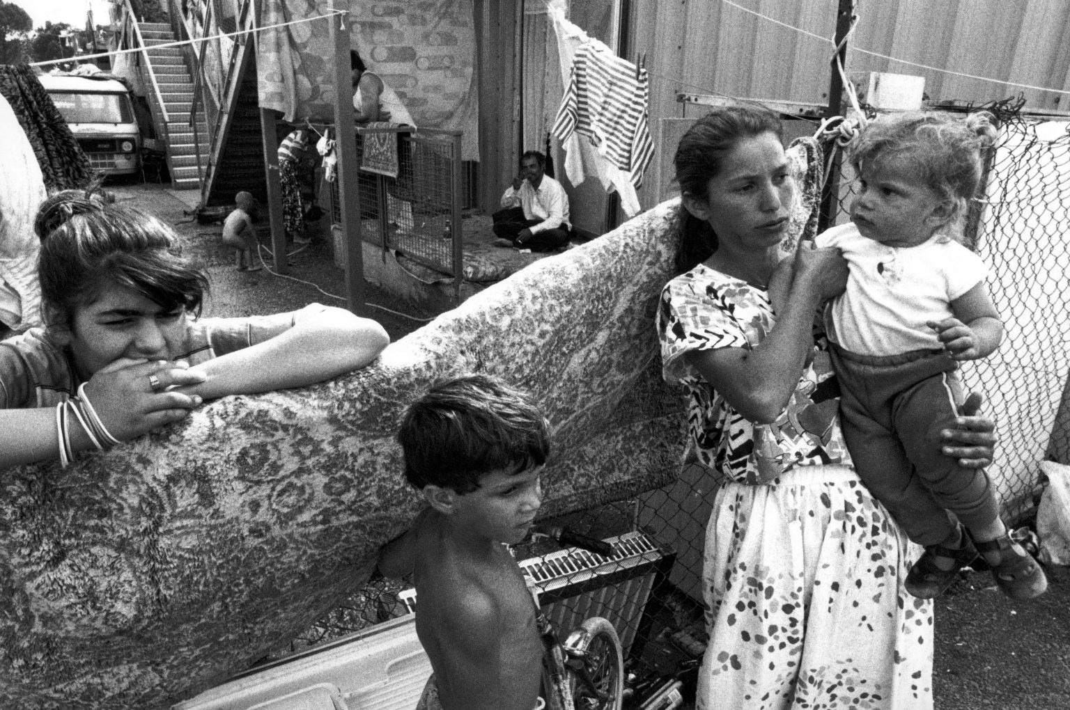 """Italy , 80's (the eighties) - In a nomads camp , young mother with sons   Italia , anni 80 - In un campo nomadi , giovane madre con figli <p><span style=""""color: #ff0000""""><strong>*** SPECIAL   FEE   APPLIES ***</strong></span></p>"""