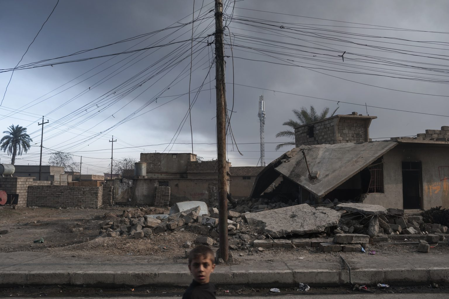 Qayyara, Iraq - November 11th 2016 - View of the ouskits of the town, in the picture damaged houses by the bombings. The oil town has been the object of intense fighting between Iraqi forces and the state Islamic group, who before retiring set fire to refineries in the city, creating an environmental disaster that It is going on for about 4 months Ph.Giulio Piscitelli