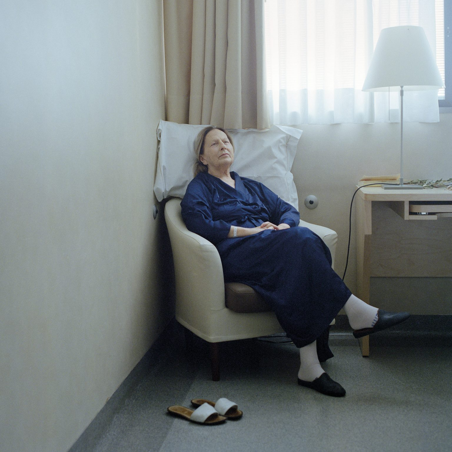 Milan, Italy. Serenella Pacifici, 71 years old, in the surgery ward of the European Institute of Oncology, waiting to be operated on for a lung cancer. She had been smoking since she was 17. In Italy, 7% of the funds spent on the health system are used on treatments linked to smoking.