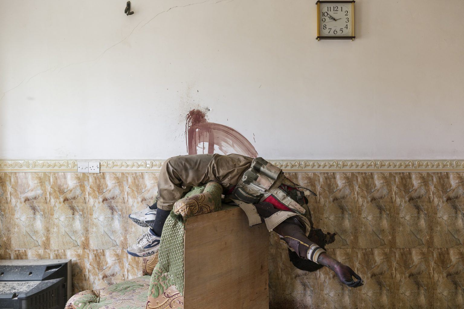 Mosu, Iraq - May 13th 2017 - The body of an Islamic State fighter is seen inside an house of the new liberated area of the city of Mosul. Ph.Giulio Piscitelli