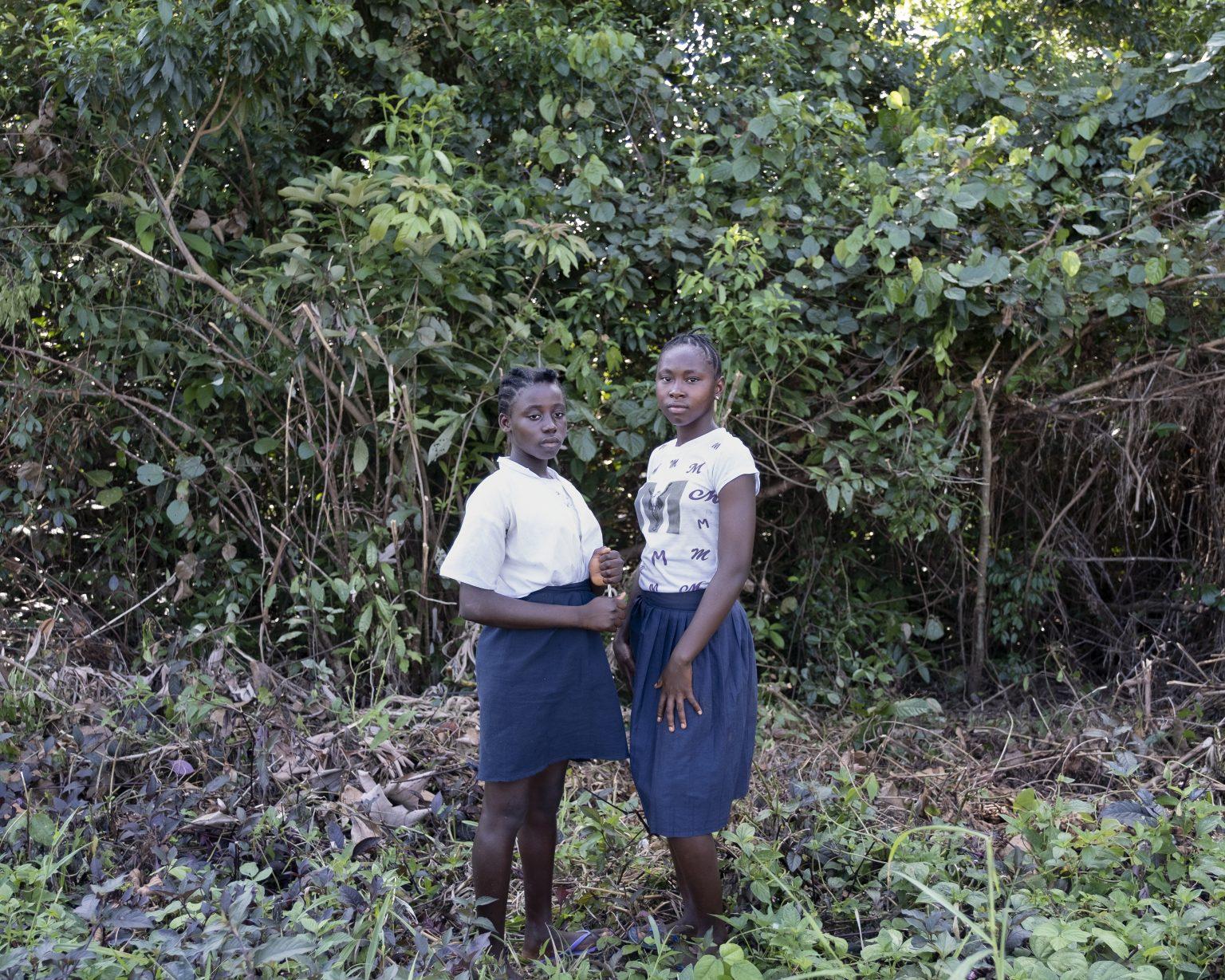 """Northwestern Liberia, October 2019 - Two primary school students, aged 13 and 14. Both attended the """"bush school"""" when they were 3 and 4 years old respectively. About the genital mutilation they suffered, they remember they wanted to escape, but they were too small to be able to run away. >< Liberia nord-occidentale, ottobre 2019 -  Due alunne della scuola primaria, di 13 e 14 anni. Entrambe sono state nella """"scuola nella foresta"""" quando avevano rispettivamente 3 e 4 anni. Della mutilazione genitale ricordano che volevano scappare, ma erano troppo piccole per poter correre."""