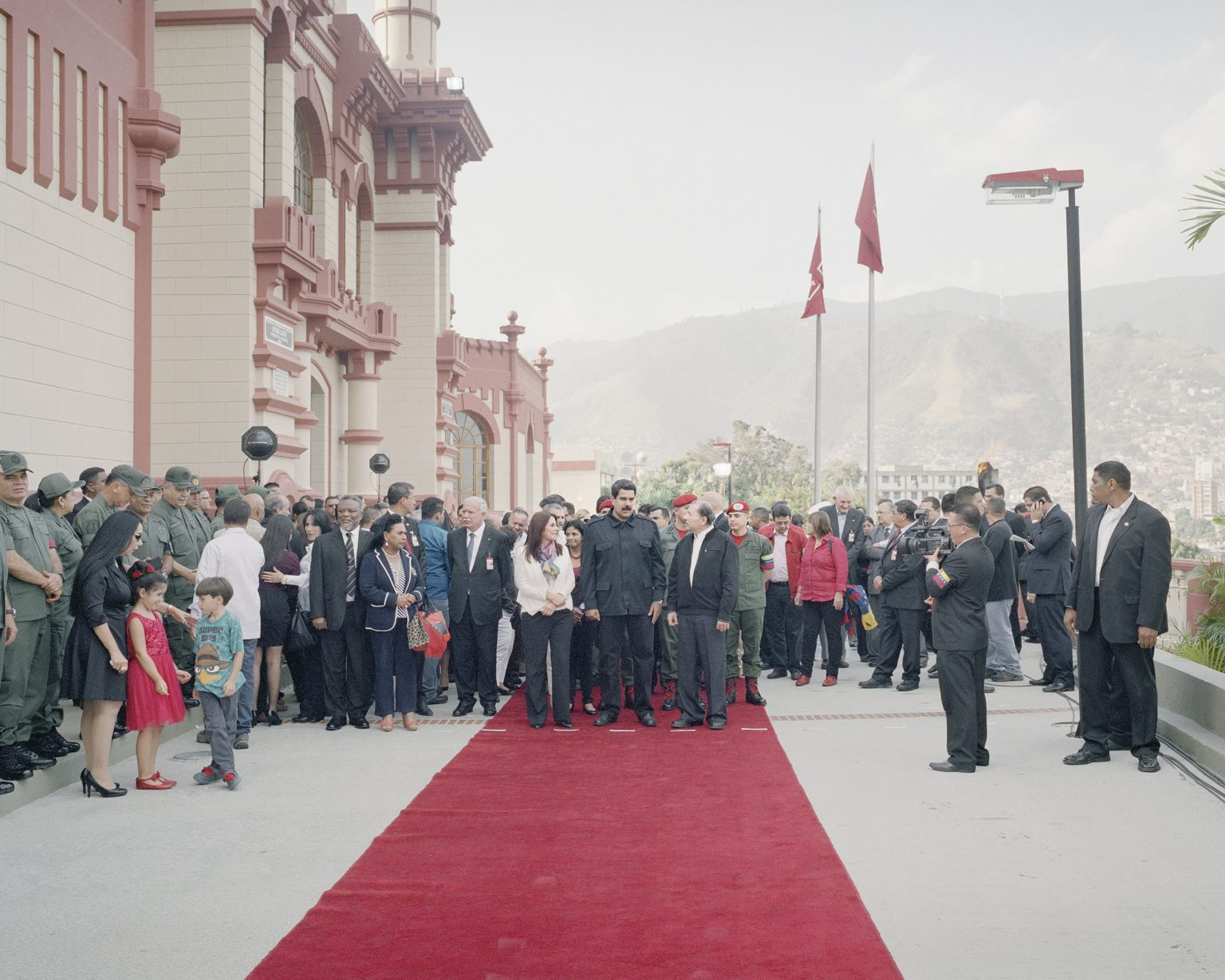 """First year aniversary of the death of Chavez. President Maduro partecipating to the cerimony at the Chavez mausoleum, located in the bidonville """"24 de enero""""."""