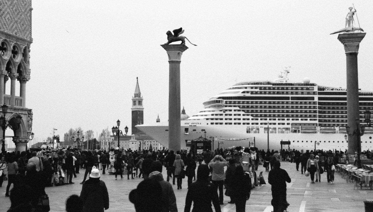 """Venice, April 2013 - Big cruise liners invade the city - MSC Divina cruise ship passing by St Mark's Square ><  Venezia, aprile 2013 - Le grandi navi da crociera invadono la città - La MSC Divina passa davanti a piazza San Marco<p><span style=""""color: #ff0000""""><strong>*** SPECIAL   FEE   APPLIES ***</strong></span></p>*** SPECIAL   FEE   APPLIES *** *** Local Caption *** 00473486"""