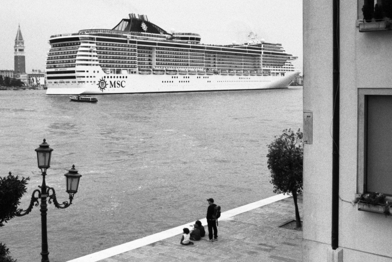 """Venice, April 2013 - Big cruise liners invade the city - MSC Divina cruise ship passing by the old town ><  Venezia, aprile 2013 - Le grandi navi da crociera invadono la città - La MSC Divina passa davanti al centro storico<p><span style=""""color: #ff0000""""><strong>*** SPECIAL   FEE   APPLIES ***</strong></span></p>*** SPECIAL   FEE   APPLIES *** *** Local Caption *** 00473487"""