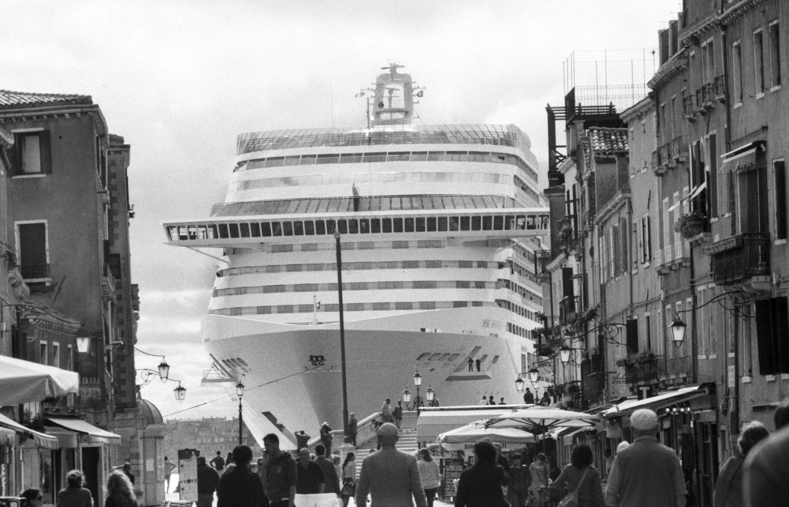 """Venice, April 2013 - Big cruise liners invade the city - MSC Divina cruise ship passing by the old town ><  Venezia, aprile 2013 - Le grandi navi da crociera invadono la città - La MSC Divina passa davanti al centro storico<p><span style=""""color: #ff0000""""><strong>*** SPECIAL   FEE   APPLIES ***</strong></span></p>*** SPECIAL   FEE   APPLIES *** *** Local Caption *** 00473488"""