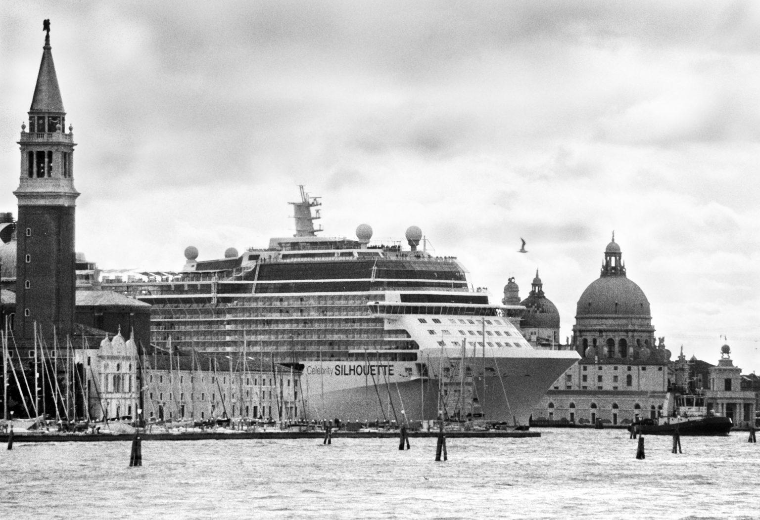 """Venice, April 2013 - Big cruise liners invade the city - Celebrity Silhouette Solstice-class cruise ship passing by the old town ><  Venezia, aprile 2013 - Le grandi navi da crociera invadono la città - La nave da crociera Celebrity Silhouette passa davanti al centro storico<p><span style=""""color: #ff0000""""><strong>*** SPECIAL   FEE   APPLIES ***</strong></span></p>*** SPECIAL   FEE   APPLIES *** *** Local Caption *** 00473494"""
