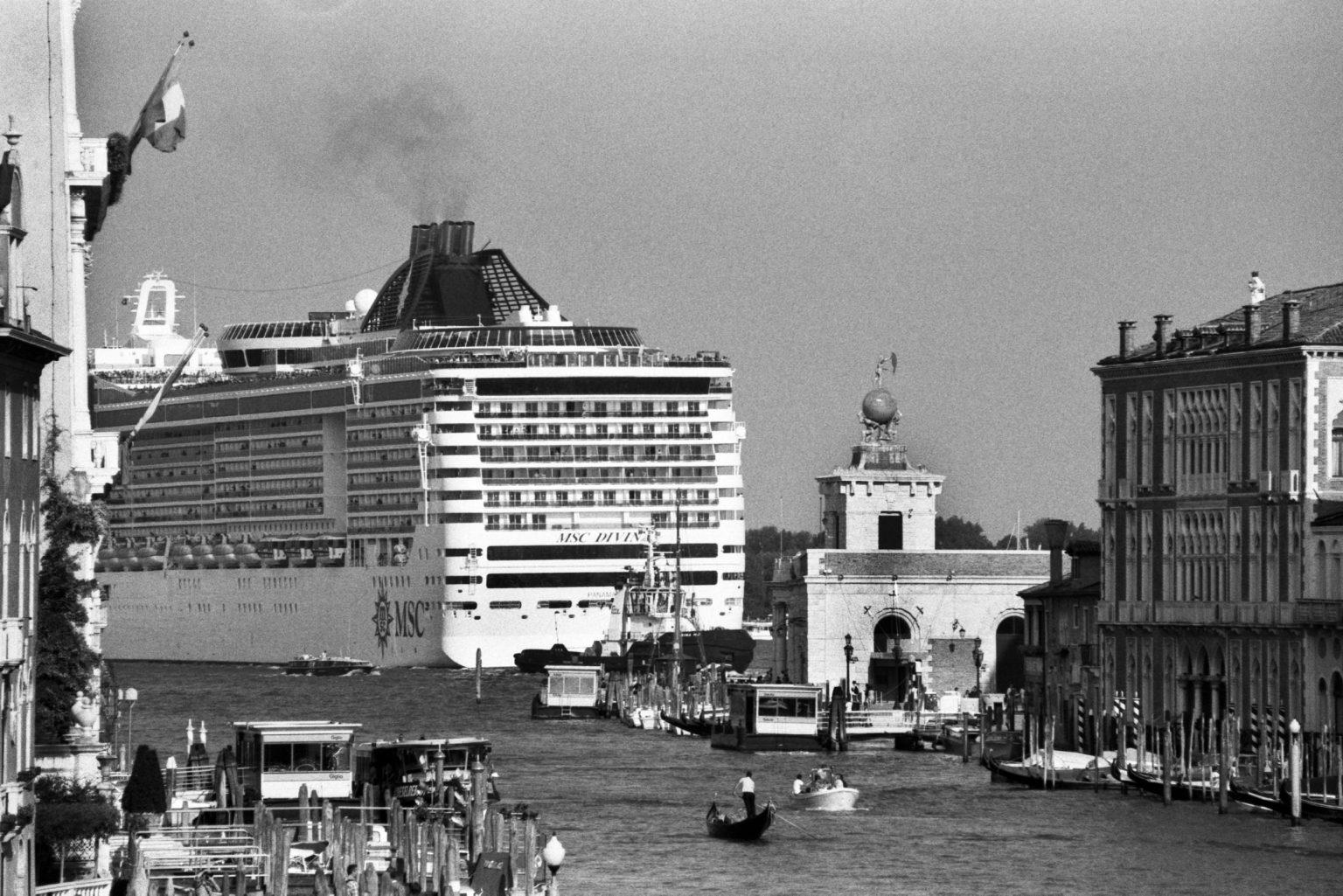 """Venice, August 2013 - Big cruise liners invade the city - MSC Divina cruise ship passing by the old town ><  Venezia, agosto 2013 - Le grandi navi da crociera invadono la città - La MSC Divina passa davanti al centro storico<p><span style=""""color: #ff0000""""><strong>*** SPECIAL   FEE   APPLIES ***</strong></span></p>*** SPECIAL   FEE   APPLIES *** *** Local Caption *** 00483760"""
