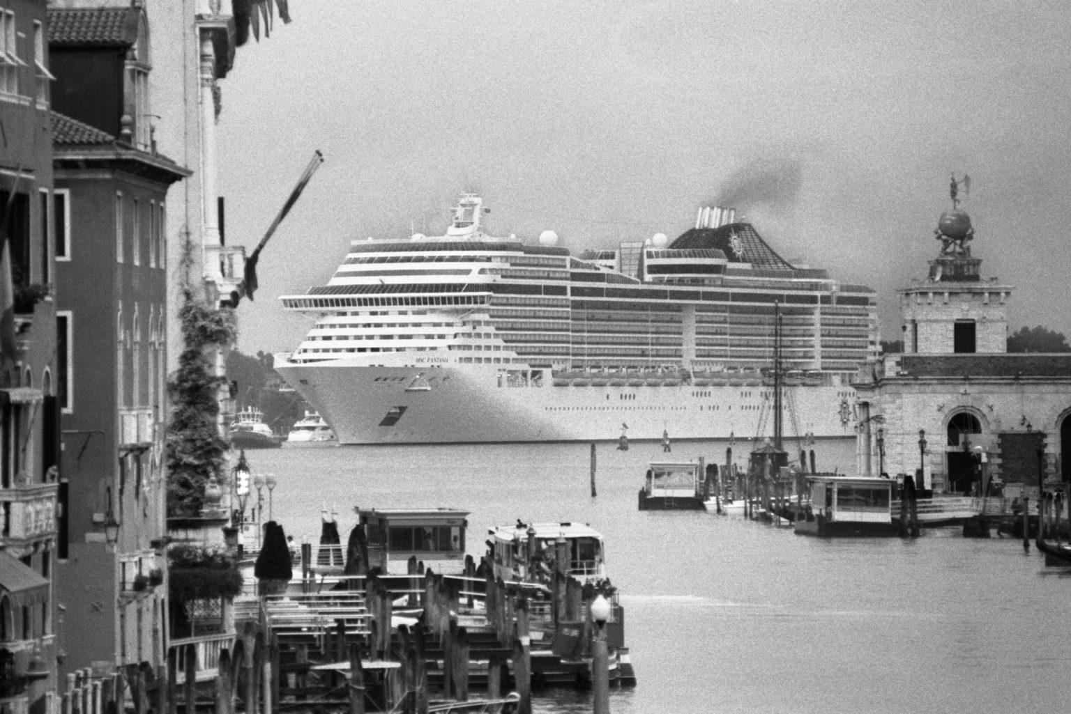 """Venice, August 2013 - Big cruise liners invade the city - MSC Fantasia cruise ship passing by the old town ><  Venezia, agosto 2013 - Le grandi navi da crociera invadono la città - La MSC Fantasia passa davanti al centro storico<p><span style=""""color: #ff0000""""><strong>*** SPECIAL   FEE   APPLIES ***</strong></span></p>*** SPECIAL   FEE   APPLIES *** *** Local Caption *** 00483762"""