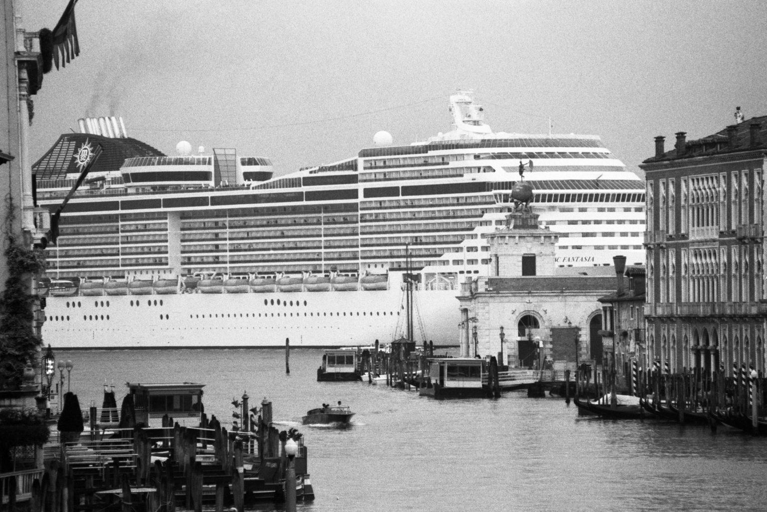 """Venice, August 2013 - Big cruise liners invade the city - MSC Fantasia cruise ship passing by the old town ><  Venezia, agosto 2013 - Le grandi navi da crociera invadono la città - La MSC Fantasia passa davanti al centro storico<p><span style=""""color: #ff0000""""><strong>*** SPECIAL   FEE   APPLIES ***</strong></span></p>*** SPECIAL   FEE   APPLIES *** *** Local Caption *** 00483767"""
