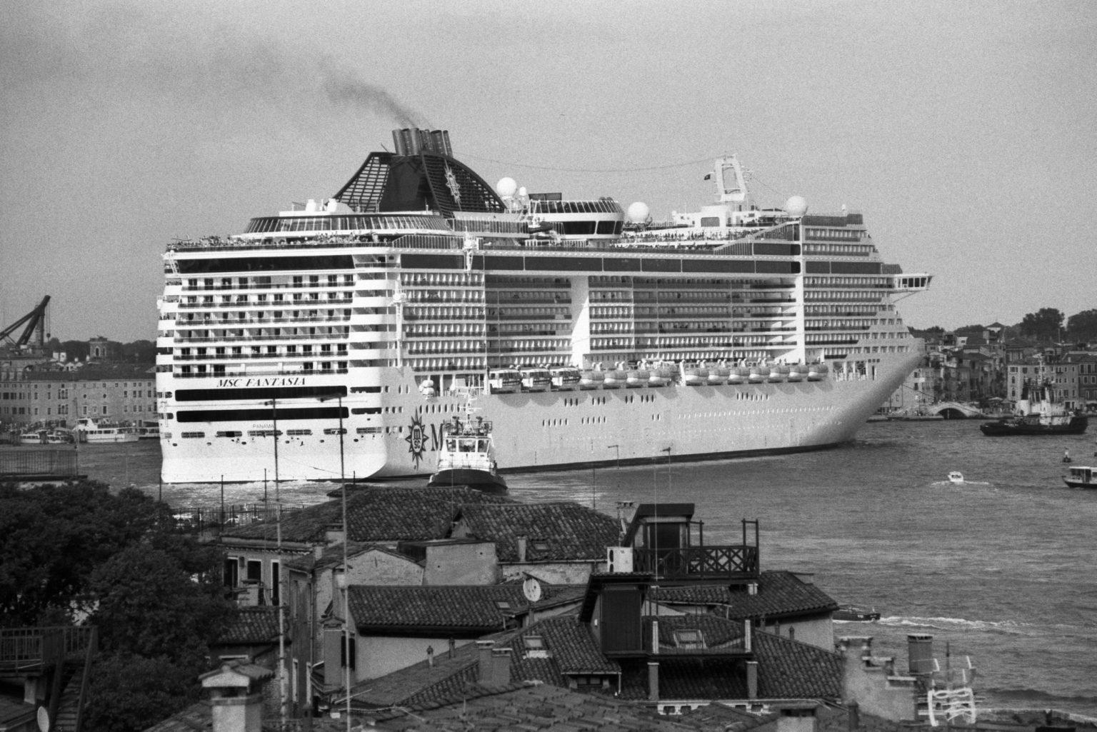 """Venice, August 2013 - Big cruise liners invade the city - MSC Divina cruise ship passing by the old town ><  Venezia, agosto 2013 - Le grandi navi da crociera invadono la città - La MSC Divina passa davanti al centro storico<p><span style=""""color: #ff0000""""><strong>*** SPECIAL   FEE   APPLIES ***</strong></span></p>*** SPECIAL   FEE   APPLIES *** *** Local Caption *** 00483766"""