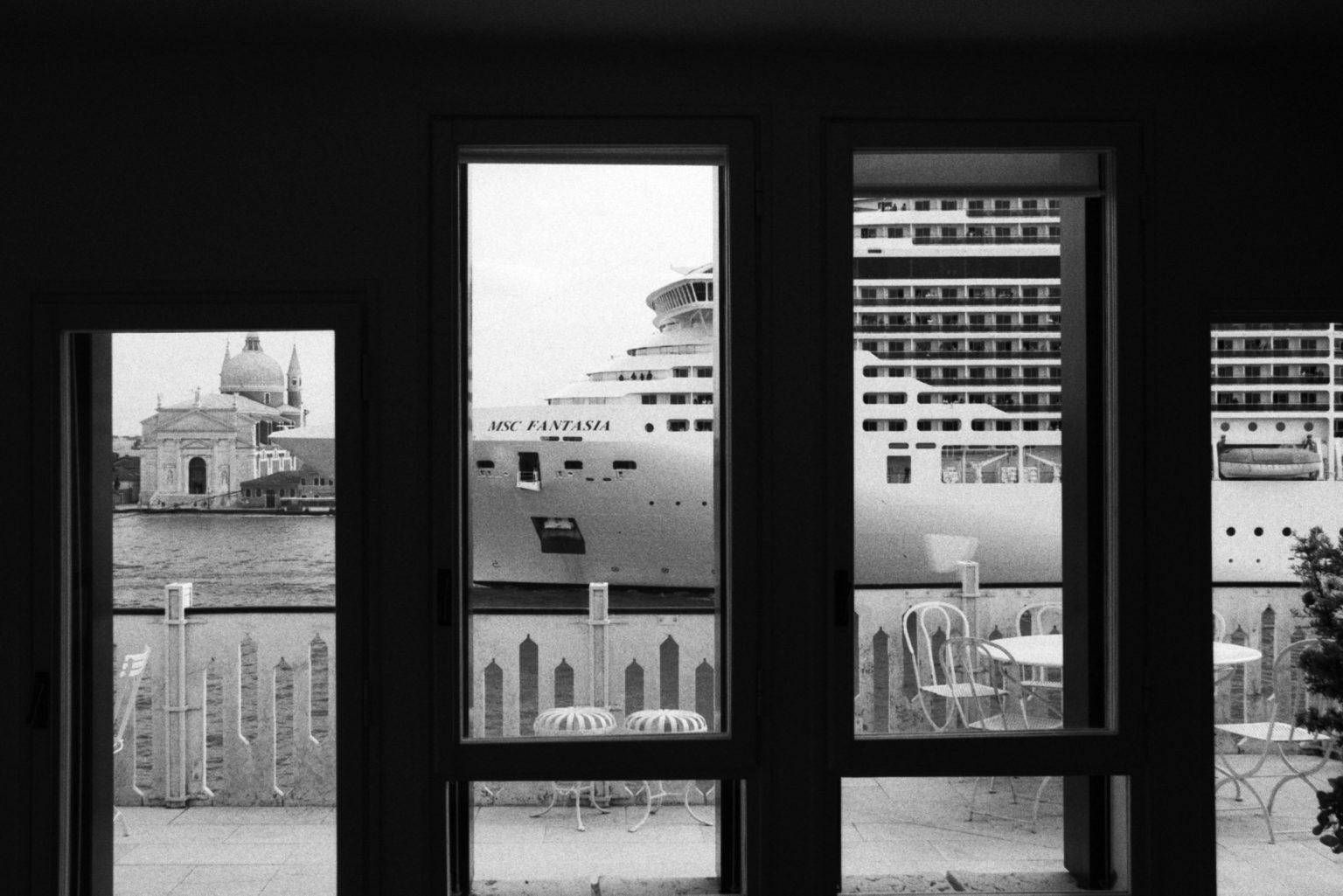 """Venice, August 2013 - Big cruise liners invade the city - MSC Fantasia cruise ship passing by the old town ><  Venezia, agosto 2013 - Le grandi navi da crociera invadono la città - La MSC Fantasia passa davanti al centro storico<p><span style=""""color: #ff0000""""><strong>*** SPECIAL   FEE   APPLIES ***</strong></span></p>*** SPECIAL   FEE   APPLIES *** *** Local Caption *** 00483768"""
