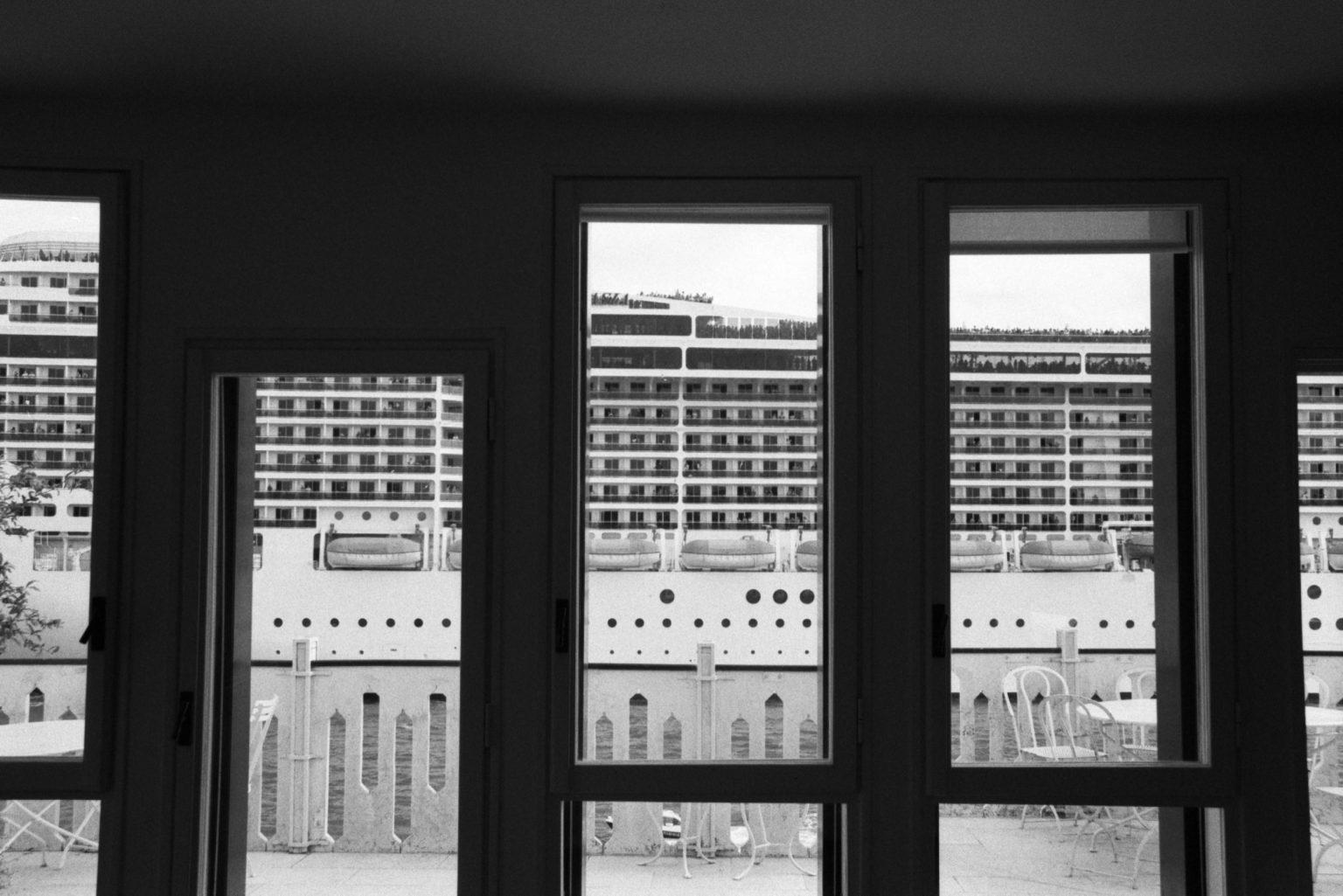 """Venice, August 2013 - Big cruise liners invade the city - MSC Fantasia cruise ship passing by the old town ><  Venezia, agosto 2013 - Le grandi navi da crociera invadono la città - La MSC Fantasia passa davanti al centro storico<p><span style=""""color: #ff0000""""><strong>*** SPECIAL   FEE   APPLIES ***</strong></span></p>*** SPECIAL   FEE   APPLIES *** *** Local Caption *** 00483761"""