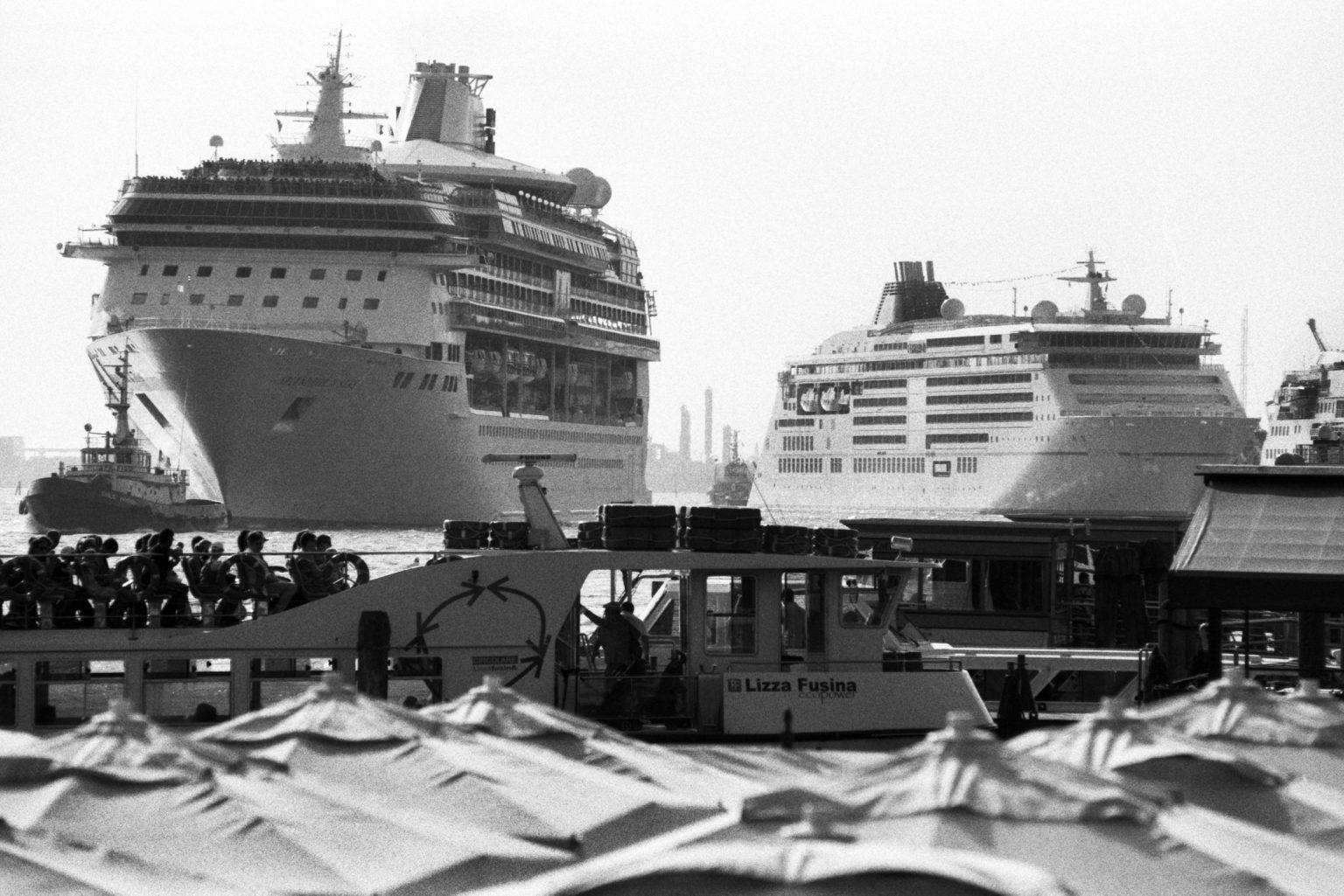 """Venice, August 2013 - Big cruise liners invade the city - Cruise ships passing by the old town ><  Venezia, agosto 2013 - Le grandi navi da crociera invadono la città - Transatlantici passano davanti al centro storico<p><span style=""""color: #ff0000""""><strong>*** SPECIAL   FEE   APPLIES ***</strong></span></p>*** SPECIAL   FEE   APPLIES *** *** Local Caption *** 00483763"""