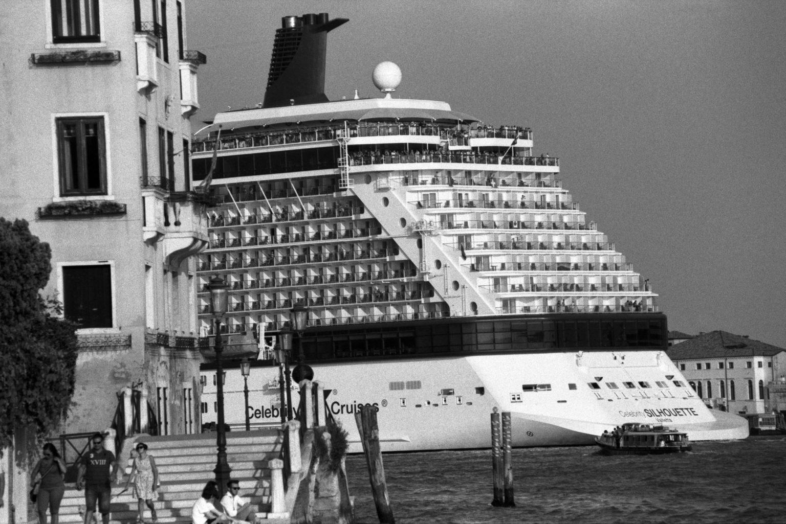 """Venice, August 2013 - Big cruise liners invade the city - MSC Celebrity Silhouette cruise ship passing by the old town ><  Venezia, agosto 2013 - Le grandi navi da crociera invadono la città - La  La nave da crociera Celebrity Silhouette Celebrity Silhouette passa davanti al centro storico<p><span style=""""color: #ff0000""""><strong>*** SPECIAL   FEE   APPLIES ***</strong></span></p>*** SPECIAL   FEE   APPLIES *** *** Local Caption *** 00483770"""