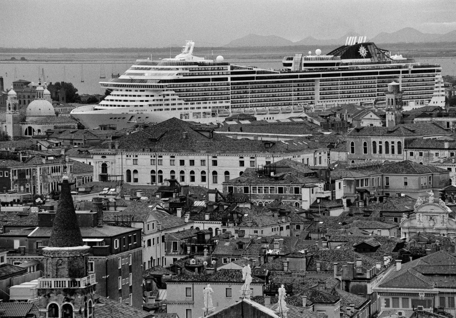 """Venice, August 2013 - Big cruise liners invade the city - MSC Preziosa cruise ship passing by the old town ><  Venezia, agosto 2013 - Le grandi navi da crociera invadono la città - La MSC Preziosa passa davanti al centro storico<p><span style=""""color: #ff0000""""><strong>*** SPECIAL   FEE   APPLIES ***</strong></span></p>*** SPECIAL   FEE   APPLIES *** *** Local Caption *** 00527934"""