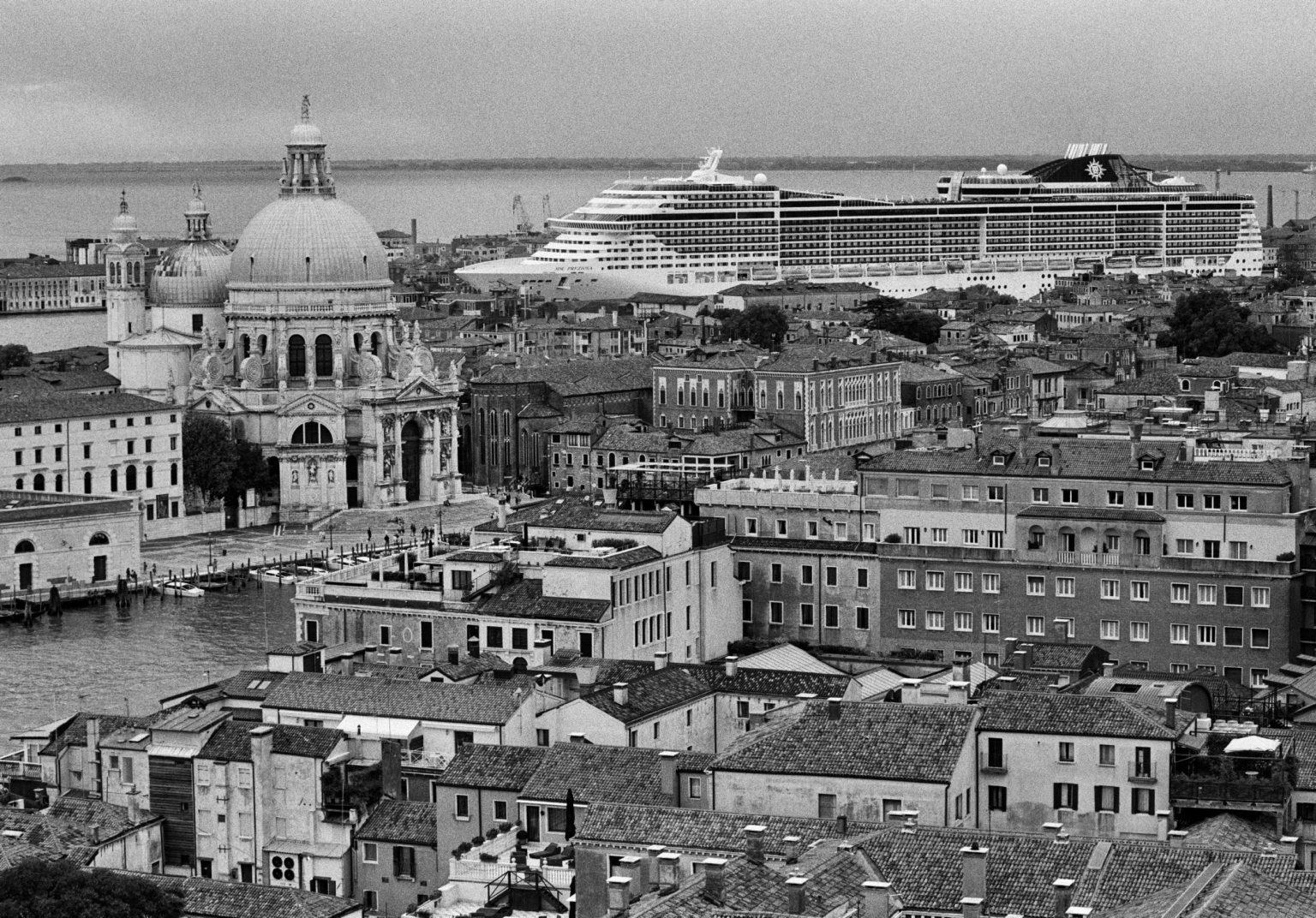 """Venice, August 2013 - Big cruise liners invade the city - MSC Preziosa cruise ship passing by the old town ><  Venezia, agosto 2013 - Le grandi navi da crociera invadono la città - La MSC Preziosa passa davanti al centro storico<p><span style=""""color: #ff0000""""><strong>*** SPECIAL   FEE   APPLIES ***</strong></span></p>*** SPECIAL   FEE   APPLIES *** *** Local Caption *** 00527936"""