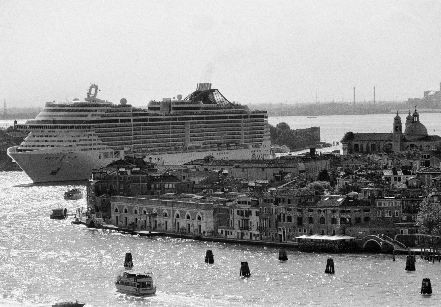 """Venice, August 2013 - Big cruise liners invade the city - MSC Fantasia cruise ship passing by the old town ><  Venezia, agosto 2013 - Le grandi navi da crociera invadono la città - La MSC Fantasia passa davanti al centro storico<p><span style=""""color: #ff0000""""><strong>*** SPECIAL   FEE   APPLIES ***</strong></span></p>*** SPECIAL   FEE   APPLIES *** *** Local Caption *** 00527935"""