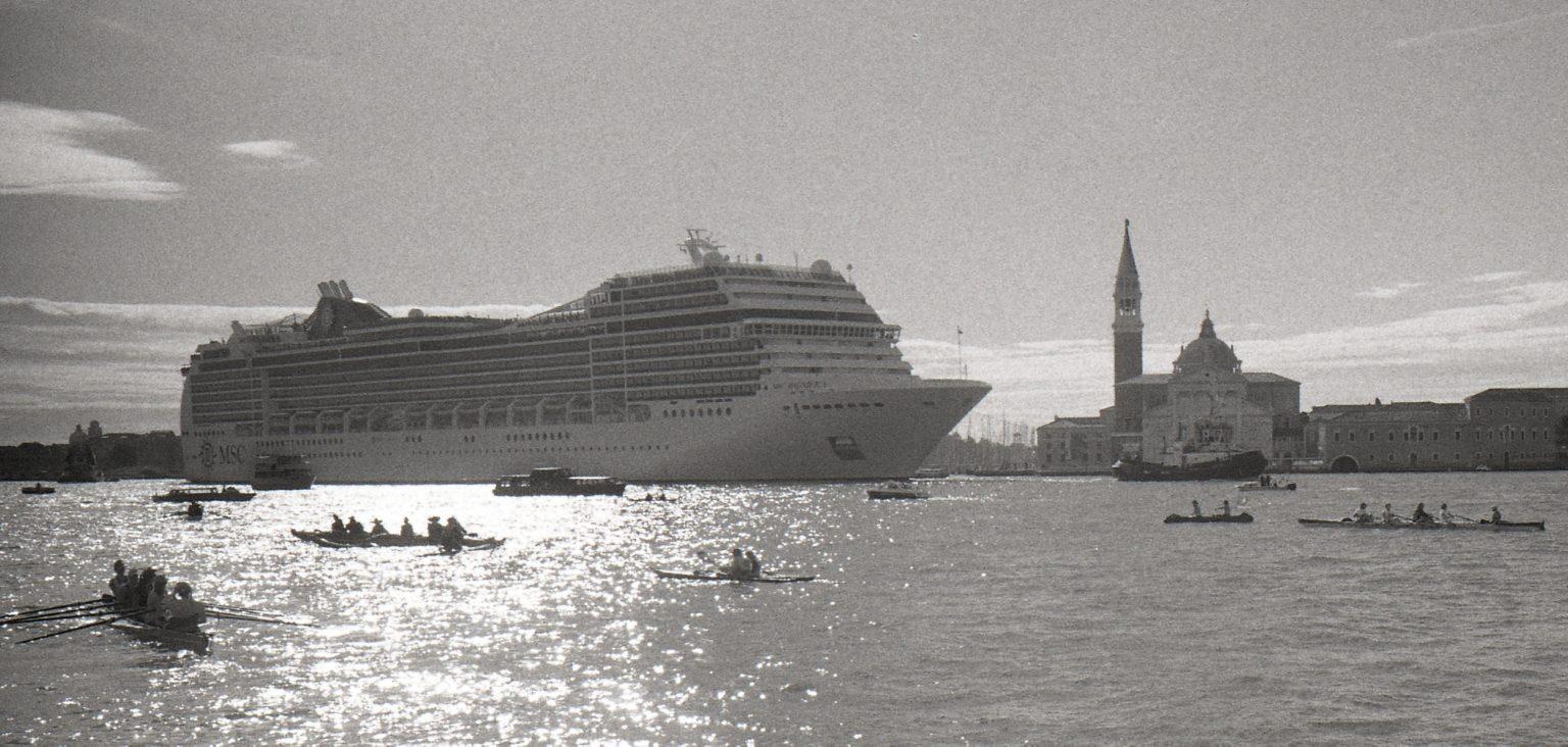 """Venice, August 2013 - Big cruise liners invade the city - Cruise ships passing by the old town ><  Venezia, agosto 2013 - Le grandi navi da crociera invadono la città - Transatlantici passano davanti al centro storico<p><span style=""""color: #ff0000""""><strong>*** SPECIAL   FEE   APPLIES ***</strong></span></p>*** SPECIAL   FEE   APPLIES *** *** Local Caption *** 00551373"""