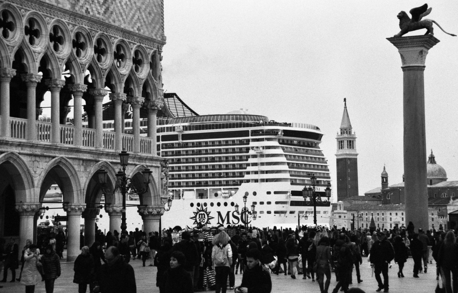 """Venice, August 2013 - Big cruise liners invade the city - MSC cruise ship passing by St. Mark's Square  ><  Venezia, agosto 2013 - Le grandi navi da crociera invadono la città - Una nave MSC passa davanti a piazza San Marco<p><span style=""""color: #ff0000""""><strong>*** SPECIAL   FEE   APPLIES ***</strong></span></p>*** SPECIAL   FEE   APPLIES *** *** Local Caption *** 00551374"""
