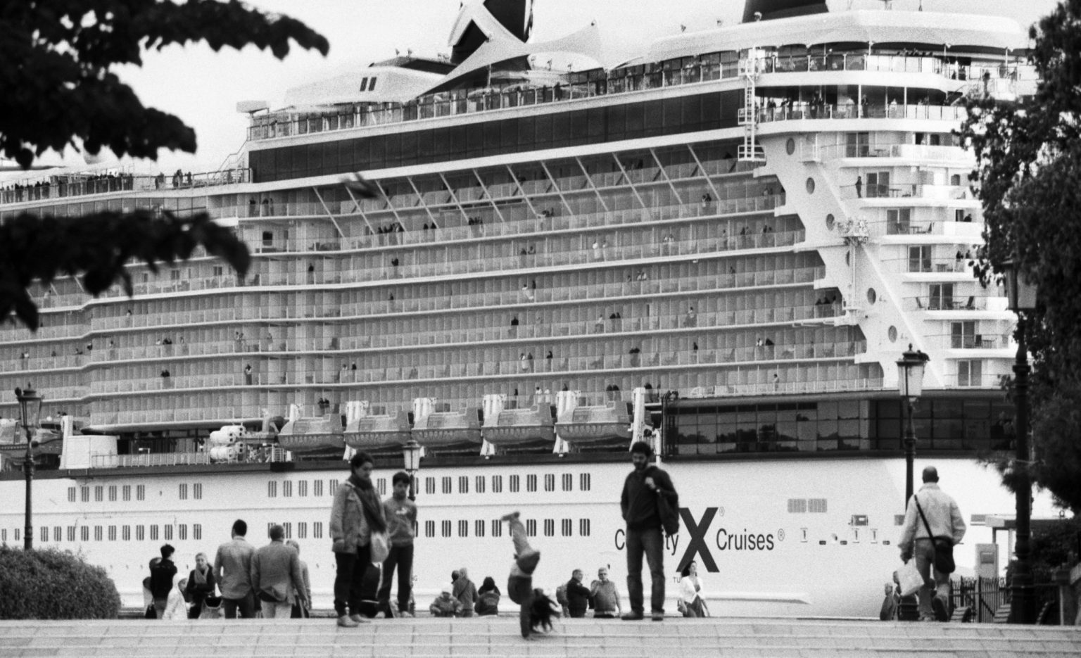 """Venice, August 2013 - Big cruise liners invade the city - Celebrity Cruises cruise ship passing by the old town ><  Venezia, agosto 2013 - Le grandi navi da crociera invadono la città - Nave Celebrity Cruises passa davanti al centro storico<p><span style=""""color: #ff0000""""><strong>*** SPECIAL   FEE   APPLIES ***</strong></span></p>*** SPECIAL   FEE   APPLIES *** *** Local Caption *** 00551372"""
