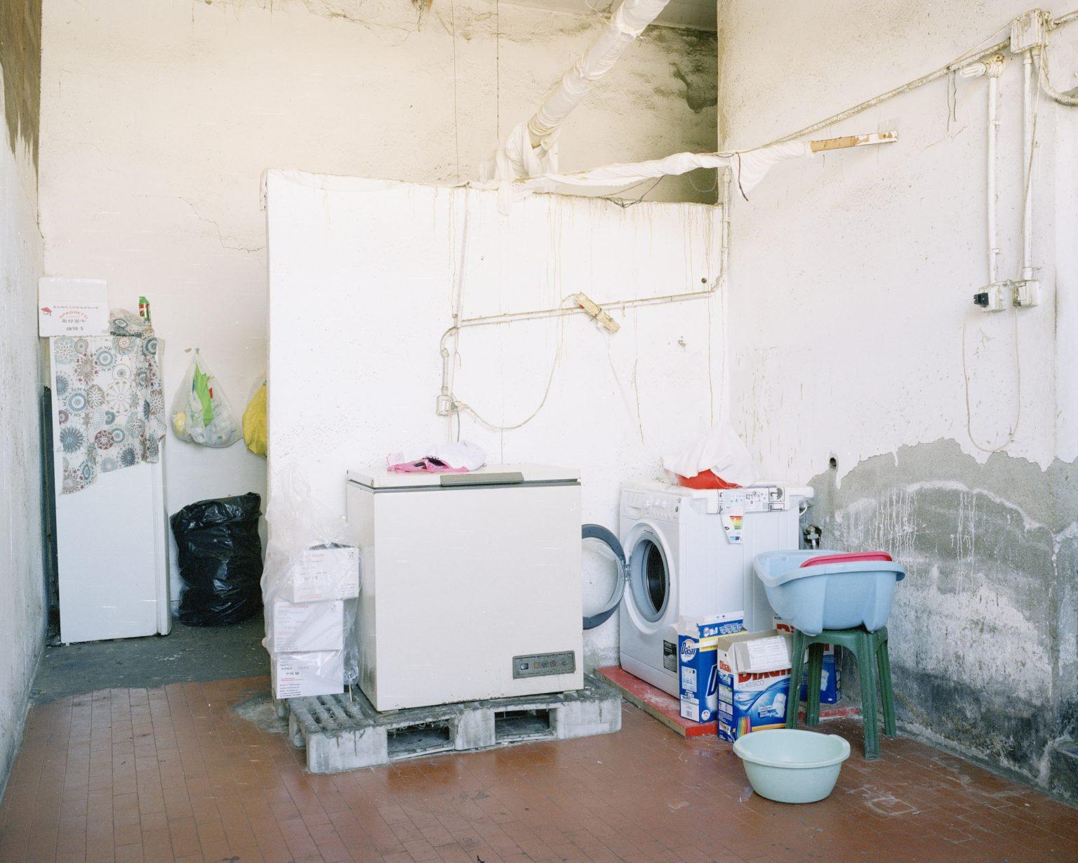 Textyle district, Prato.  Laundry in a Chinese textile workshop seized by the Municipal Police.   >< Distretto tessile del Macrolotto, Prato. lavanderia in un laboratorio tessile cinese posto sotto sequestro dalla Polizia Municipale di Prato.
