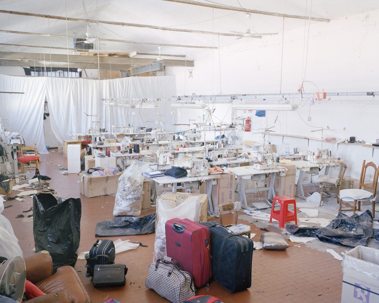 Textyle district, Prato. Chinese textile workshop seized by the Municipal Police.  >< Distretto tessile del Macrolotto, Prato. Laboratorio tessile cinese posto sotto sequestro dalla Polizia Municipale di Prato.