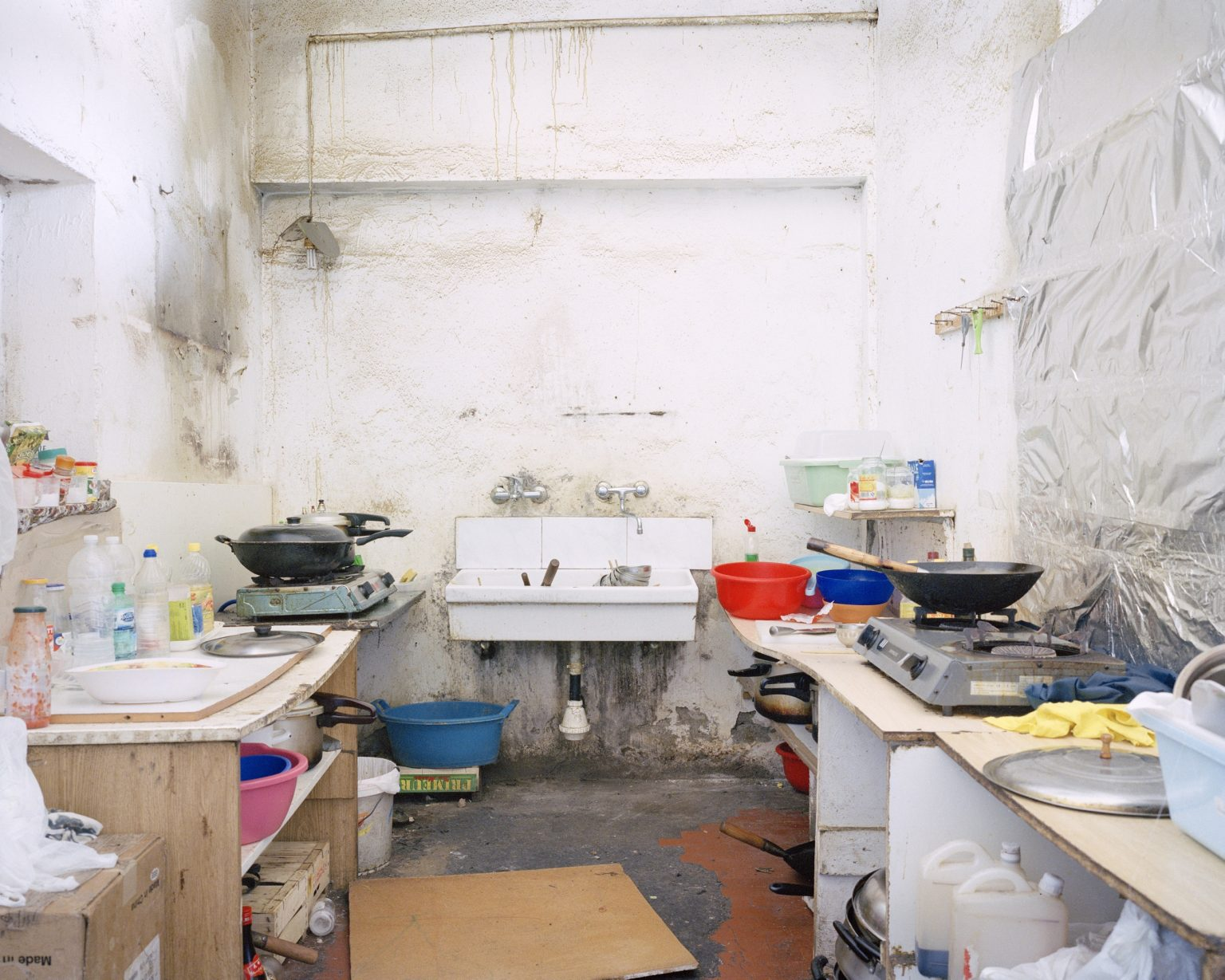 Textyle district, Prato.  Kitchen in a Chinese textile workshop seized by the Municipal Police.  >< Distretto tessile del Macrolotto, Prato. Cucina in un laboratorio tessile cinese posto sotto sequestro dalla Polizia Municipale di Prato.