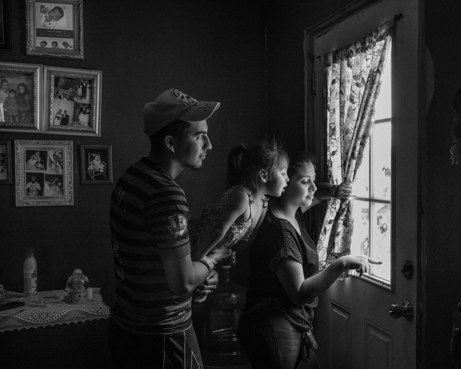 Luis Meija, 22 years old, with his wife Lizeth and their daughter Amberly, 3, in their house at colonia La PenÃÉita. Colonies are extremely poor communities of migrants, born along the border between Texas and Mexico where most people are illegally in the US.  La Joya, Texas. April, 2017.