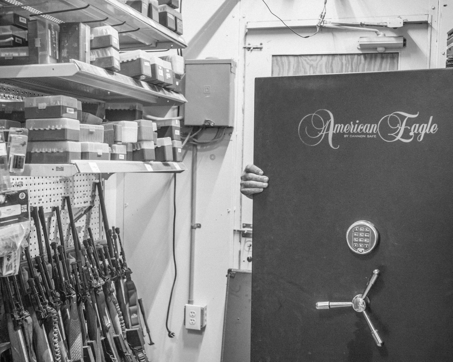 Larry Masseys, 69 years old, behind the safe where he keeps the most precious items of his armory. Brownsville, TX. April, 2017.