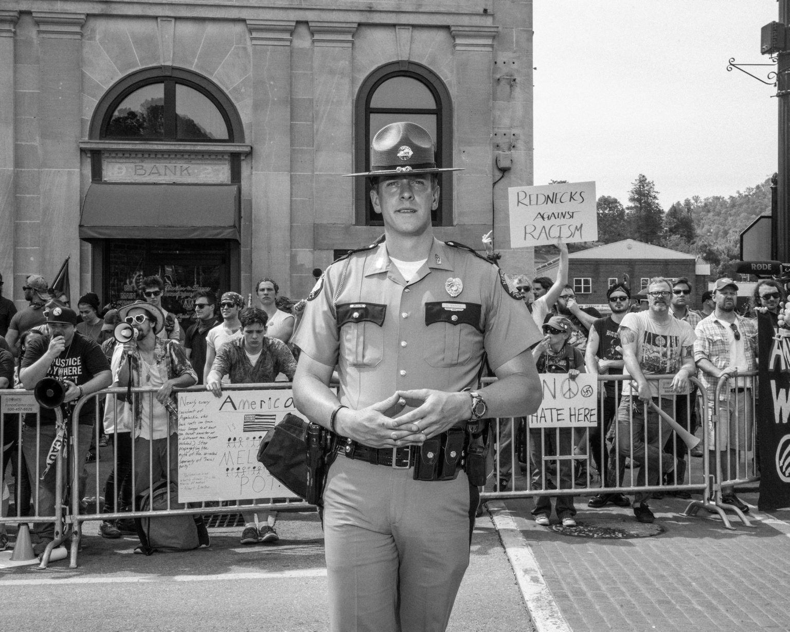 A policeman during a Ku Klux Klan and National Socialist Movement meeting in Pikeville, Kentucky, where I ended up by following the Arizona NSM delegation. Pikeville, Kentuky, April 2017.