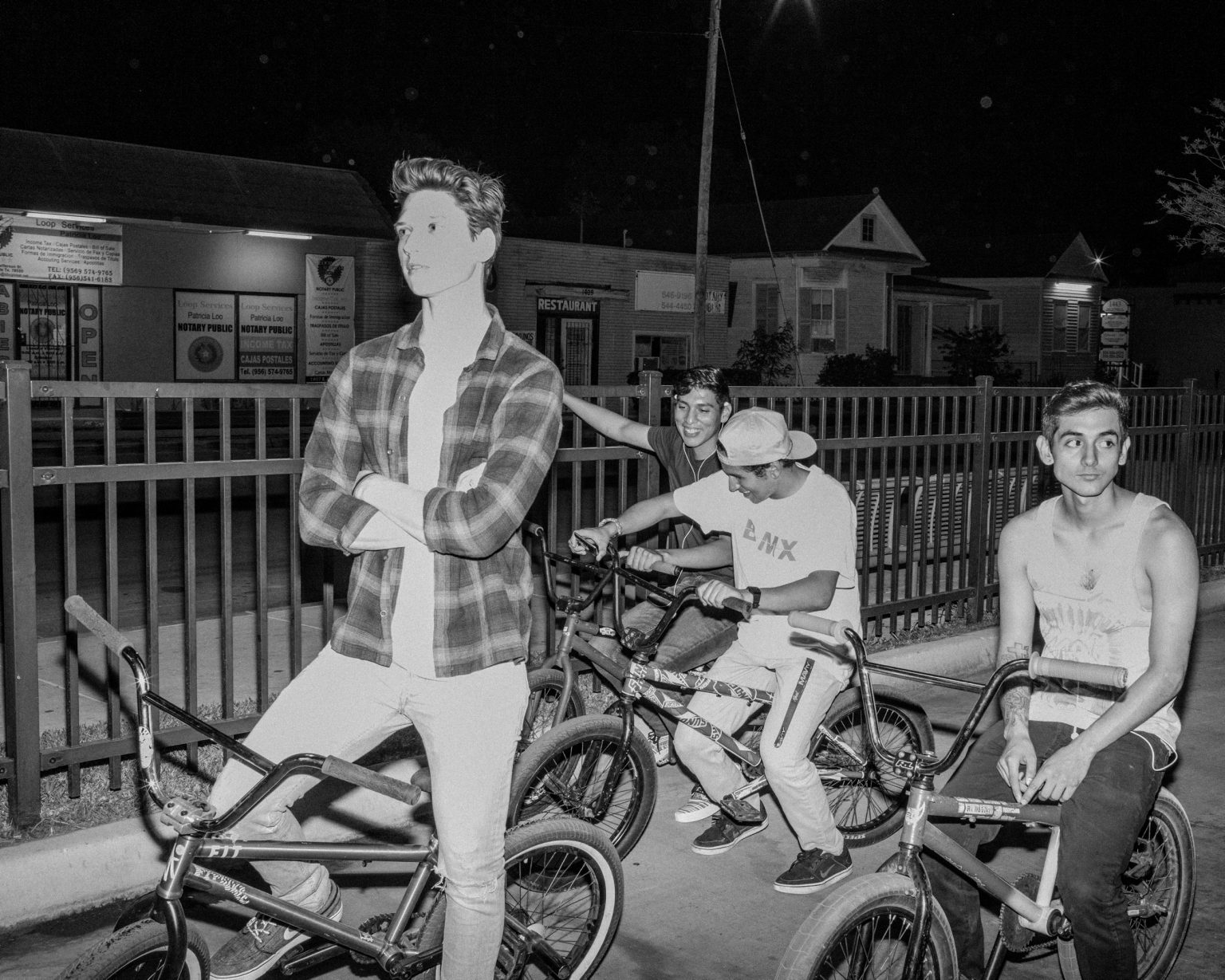 Youth on their BMXs at the bus station. Brownsville, TX. April, 2017.