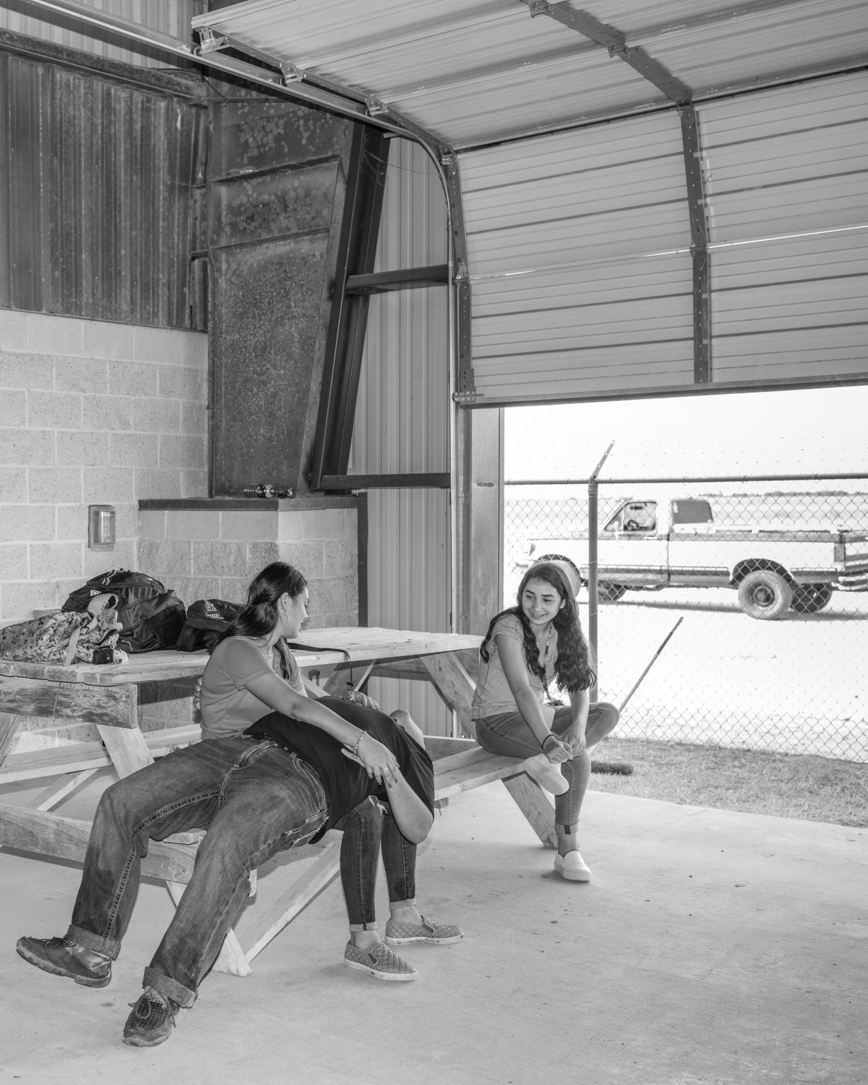Workers resting at the end of the shift at the barn. La Joya, Texas. October 2019