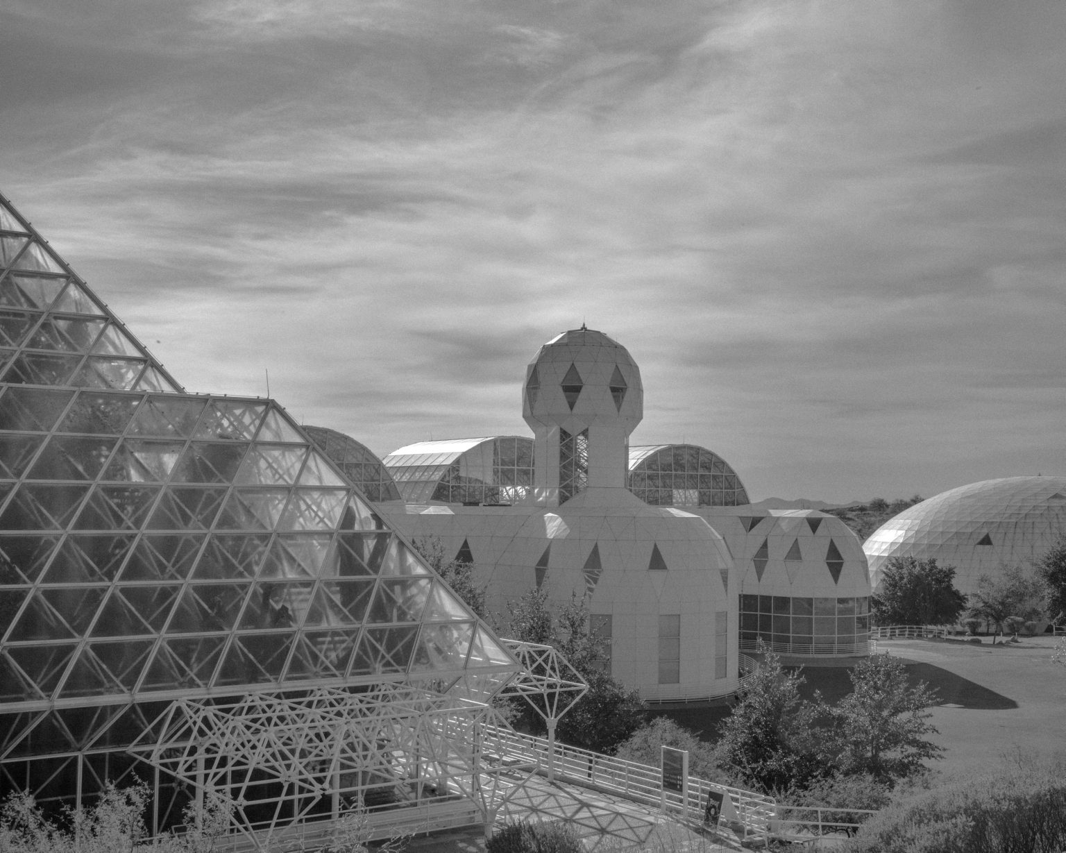 Biosphere 2 is an American Earth system science research facility located in Oracle, Arizona. Biosphere 2 was originally meant to demonstrate the viability of closed ecological systems to support and maintain human life in outer space. It was designed to explore the web of interactions within life systems in a structure with different areas based on various biological biomes. Oracle, AZ. November 2017.