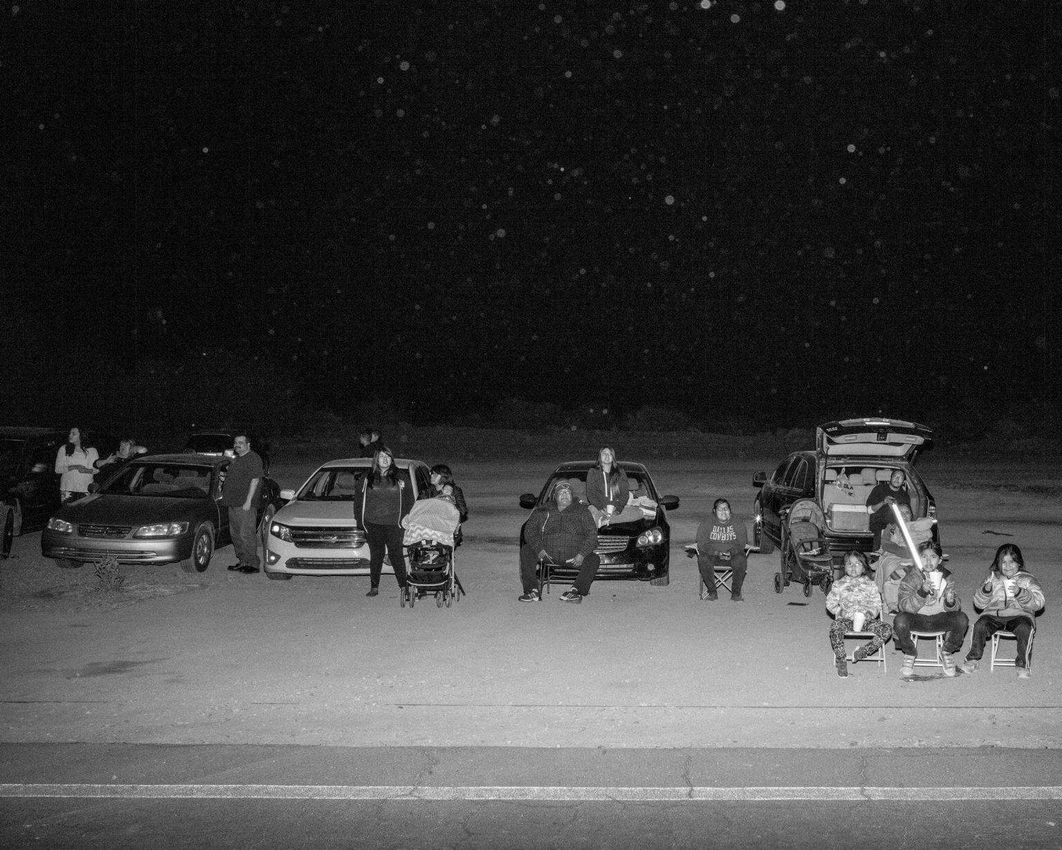 Families waiting for the Christmas parade on the  main street of the Ak Chin Native reservation. Maricopa, Arizona. December 2017.