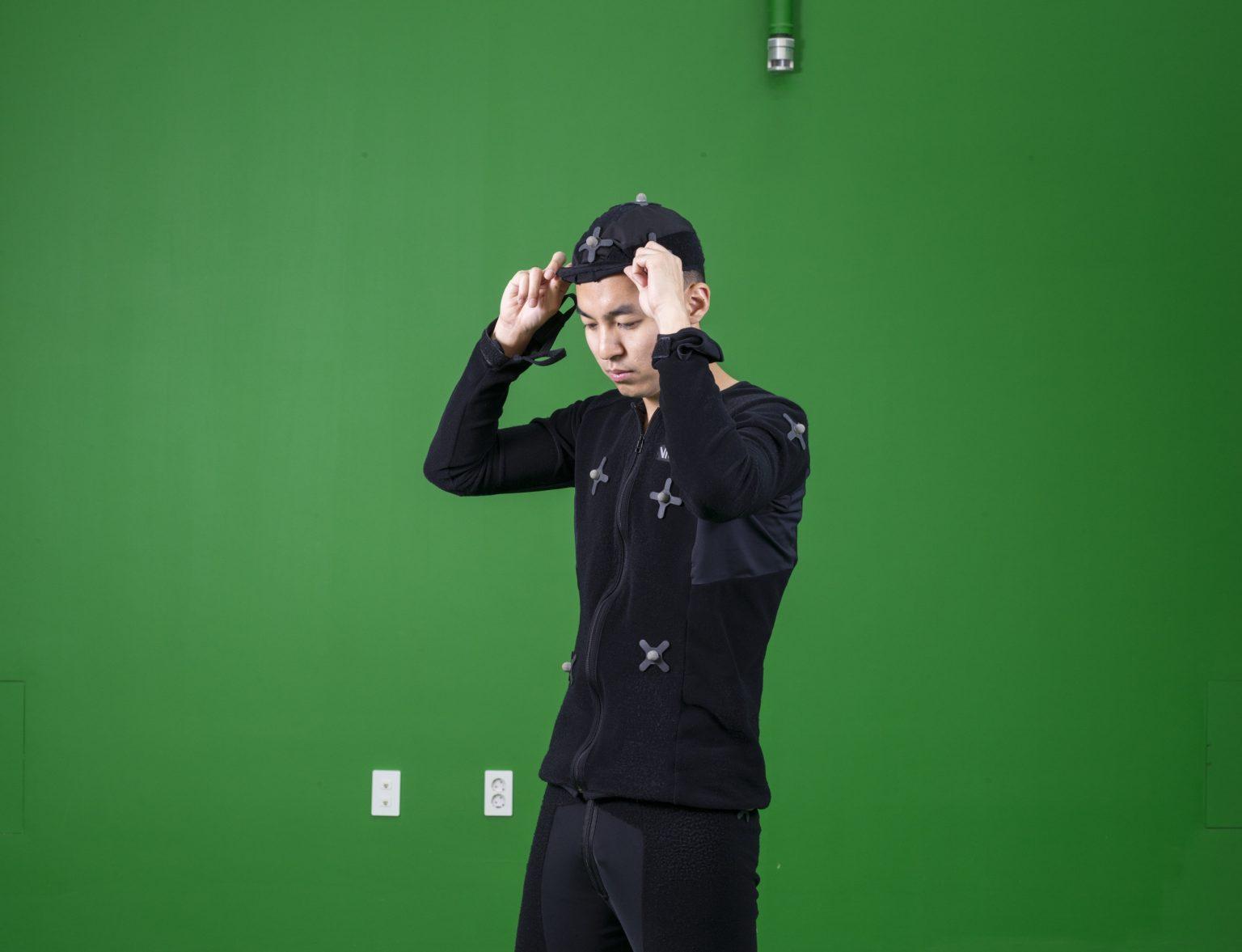 """Republic of Korea, Seongnam, G?yeonggi-do, Pangyo, September ?2015 - The making of a videoga?me in the motion room located ?in the headquarter building of? Nexon, the most important Kor?ean company of online games. T?he motion room is where the re?al body's movements are record?ed by sensors and translated i?n a 3d digital language. >< Re?pubblica di Corea, Seongam, Gy?eonggi-do, Pangyo, settembre 2?015 - Il """"making of"""" di un vid?eogioco nella motion room situ?ata nel quartier generale dell?a Nexon, il più importante pro?duttore coreano di videogiochi? online. La motion room è dove? i movimenti reali sono regist?rati dai sensori collocati sul?le tute e tradotti in linguagg?io digitale 3d. *Stitched photograph*"""