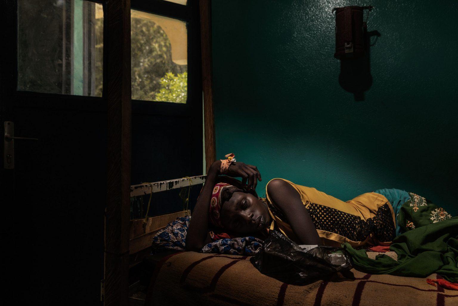 Africa, Chad, Bol, October 2018 - AIDS has spread exponentially since the Boko Haram war and worsened,  due to the sexual violence perpetrated by the Islamists.  Arta Brachir, aged 12, was admitted to hospital for a suspected case of malaria, and was diagnosed HIV positive. Fearful of the stigma, her grandmother hides the way she contracted the infection, telling people she caught it while she was having her hair plaited. >< Africa, Ciad, Bol, Ottobre 2018 - L'AIDS si è diffusa in maniera esponenziale dalla guerra di Boko Haram, per via delle violenze sessuali perpetrate dagli Islamisti. Arta Brachir, 12 anni, è stata ricoverata in ospedale per un sospetto caso di malaria, ma è stata diagnosticata positiva al virus dell'HIV. La nonna, che teme il pregiudizio, nasconde il modo in cui la ragazza ha contratto l'infezione, raccontando alle persone che è stata contagiata mentre si stava facendo le trecce ai capelli.*** SPECIAL   FEE   APPLIES *** *** Local Caption *** 01362911