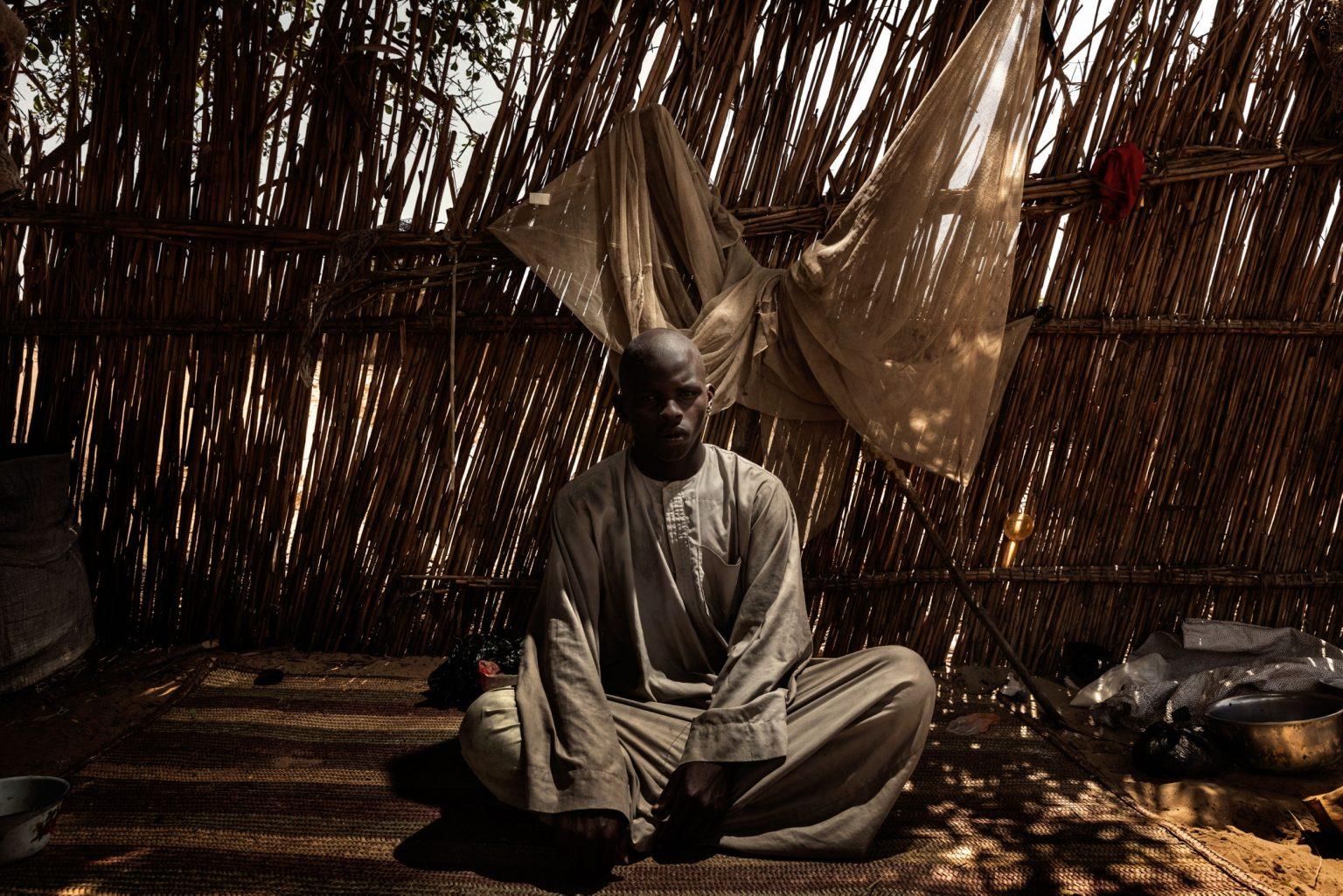 Africa, Chad, Dar es Salam, October 2018 - Madu Walli Alhadji Affeni, aged 26, was imprisoned for two years by Boko Haram, and forced to work on the land until the day he managed to escape. >< Africa, Ciad, Dar es Salam, Ottobre 2018 - Madu Walli Alhadji Affeni, 26 anni, è stato imprigionato per due anni da Boko Haram ed è stato costretto a lavorare la terra fino al giorno in cui è riuscito a scappare.*** SPECIAL   FEE   APPLIES *** *** Local Caption *** 01362902