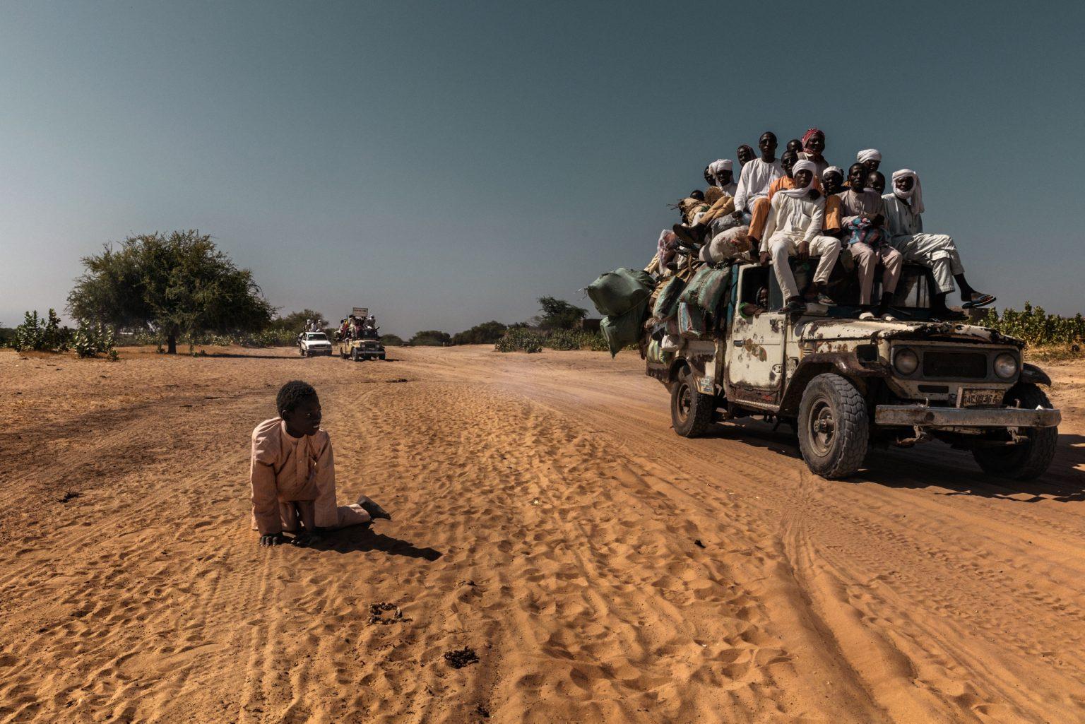 Africa, Chad, Bol, October 2018 - A paraplegic child beggar crawling across the red-hot sand to go and beg in the centre of Bol. >< Africa, Ciad, Bol, Ottobre 2018 - Un bambino mendicante paraplegico si trascina lungo le sabbie rosse e calde per andare a mendicare al centro di Bol.*** SPECIAL   FEE   APPLIES *** *** Local Caption *** 01362896