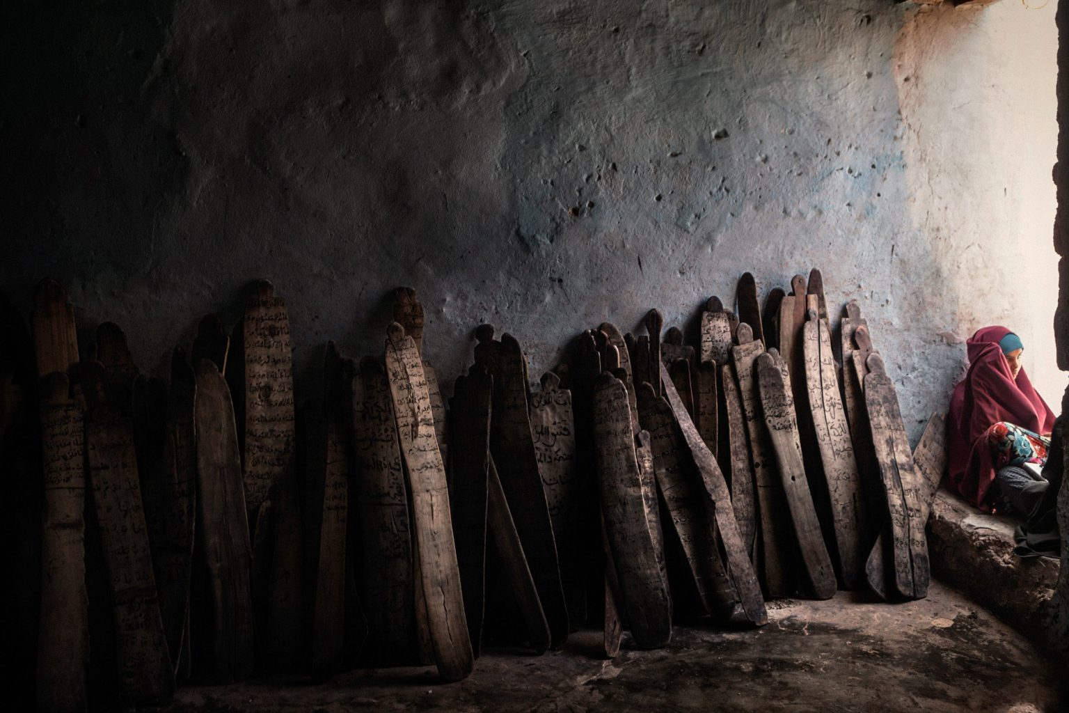 frica, Somalia, Mogadishu. 20/10/2015. Loox (traditional Somali Koranic tables of wood) by the wall in a Madrasas located in Onat refugee camp in the district of Abdi Asis. Over 700 families live in Onat refugee camp in the district of Abdi Asis. Some IDPs have been living in this tent city for more than 20 years. Living conditions are precarious, and most of the displaced have nowhere to go back to, having lost everything during the lengthy conflict. In the Madrasas of Mogadishu, Koran teachers impart the pillars of Islam to the new generations. After years of heretical dictatorship, everything must be reconstructed from the foundations, including religious faith.