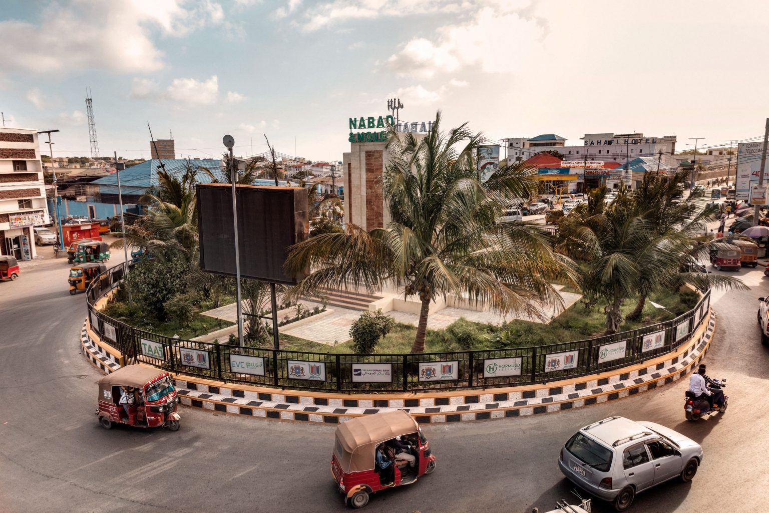 """Africa, Somalia, Benaadir region. Mogadishu. 12/09/2017. The roundabout of the Km4 square. Until 2012 the km4 was considered the edge of the """"green zone"""". The car bombs, the suicide attacks, the journalists murdered and the mortar rounds fired during the night against Villa Somalia are proof that while Al-Shabaab may have been weakened, it has not been defeated. From a struggle for position fought out on the battlefield, the movement has shifted towards a new underground, asymmetric Al-Qaeda-style strategy aimed at heightening the sense of insecurity and instability afflicting a population already drained by twenty years of fighting and famine."""
