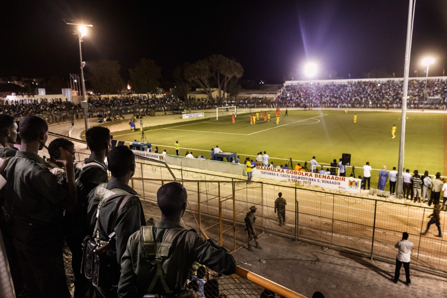 frica, Somalia, Benaadir region. Mogadishu. The soccer match between Hodan and Waberi districts, in the first night-time match since chaos descended on the Somali capital nearly three decades ago. The tournament for 16 and 18-year-olds at the Konis Stadium, renovated by FIFA, was played under tight security because of the constant threat posed by the Shabaab Islamist group. The stadium has been and remains a military base for African Union peacekeepers, who drove Al-Shabab militants out of the city in 2011.