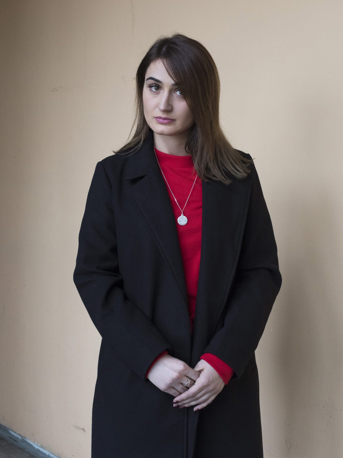 Portrait of Venera Poteri, law student, employed at the polling station n. 26 in the Linguistic faculty of Prishtina / Priština during the ballot vote for the election of the new mayor.