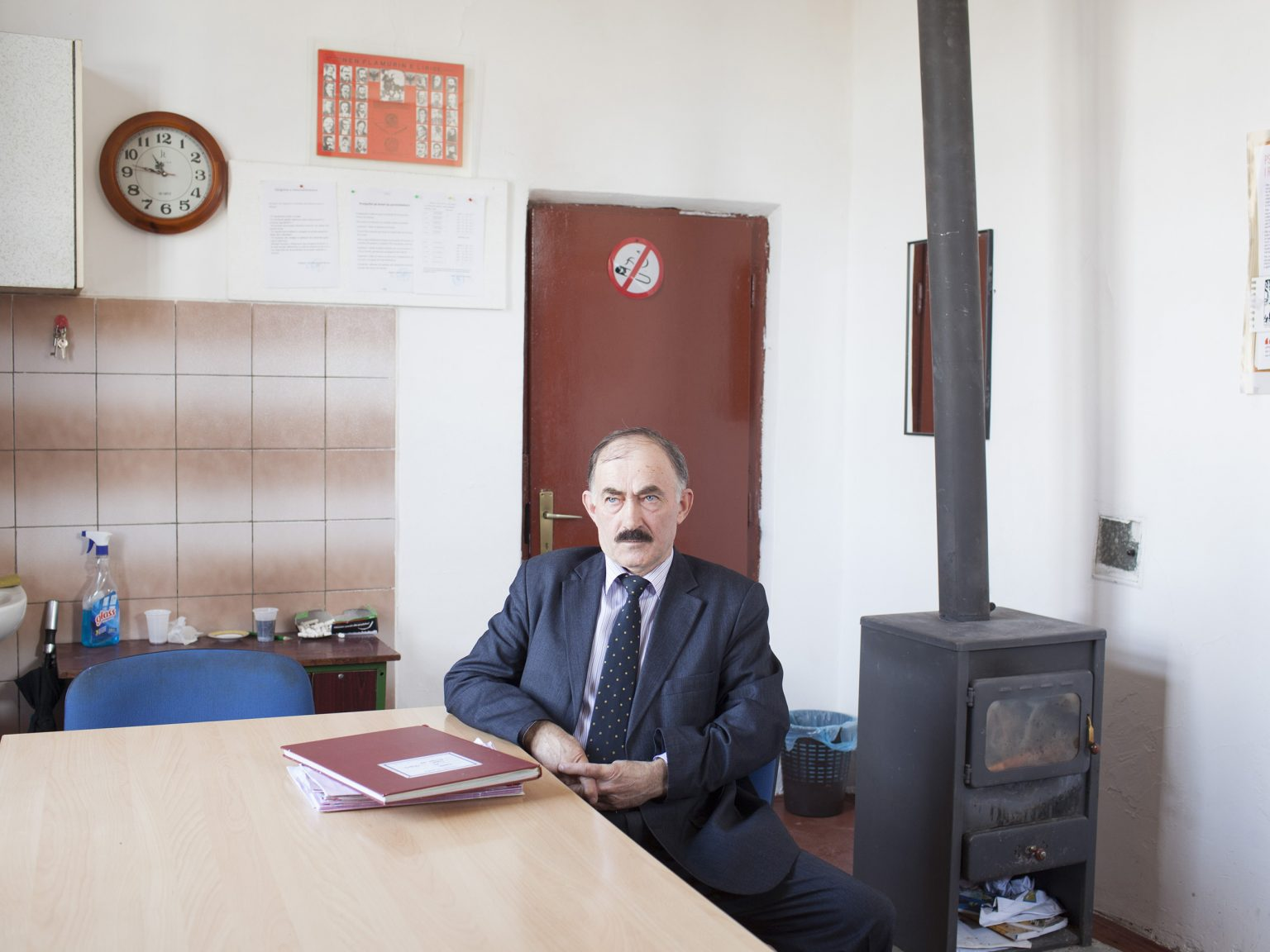 Beqir Murati, 64 years old, professor of chemistry of the divided school of Rubofc / Rubovce.  e school is divided inside by a wall, separating Serbian and Albanian students.