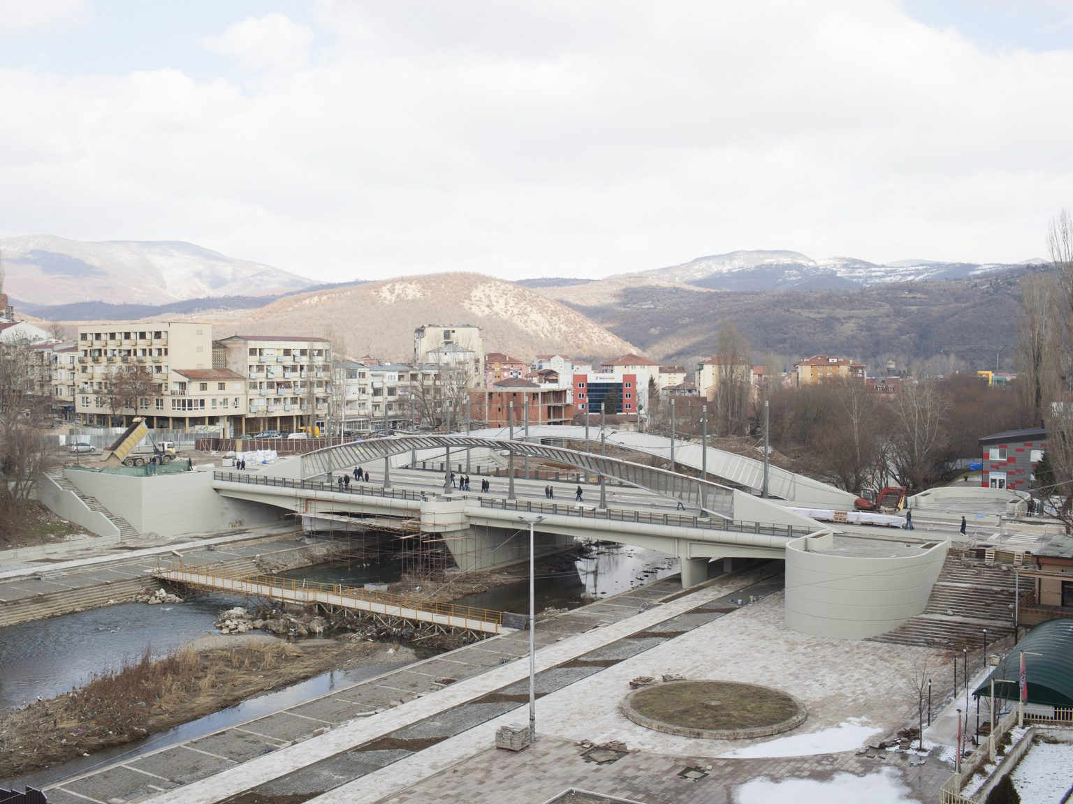 View of the Mitrovica / Kosovska Mitrovica bridge and the Ibar river that divides the northern Serbians-majority part of the town from the southern Albanian-majority one.