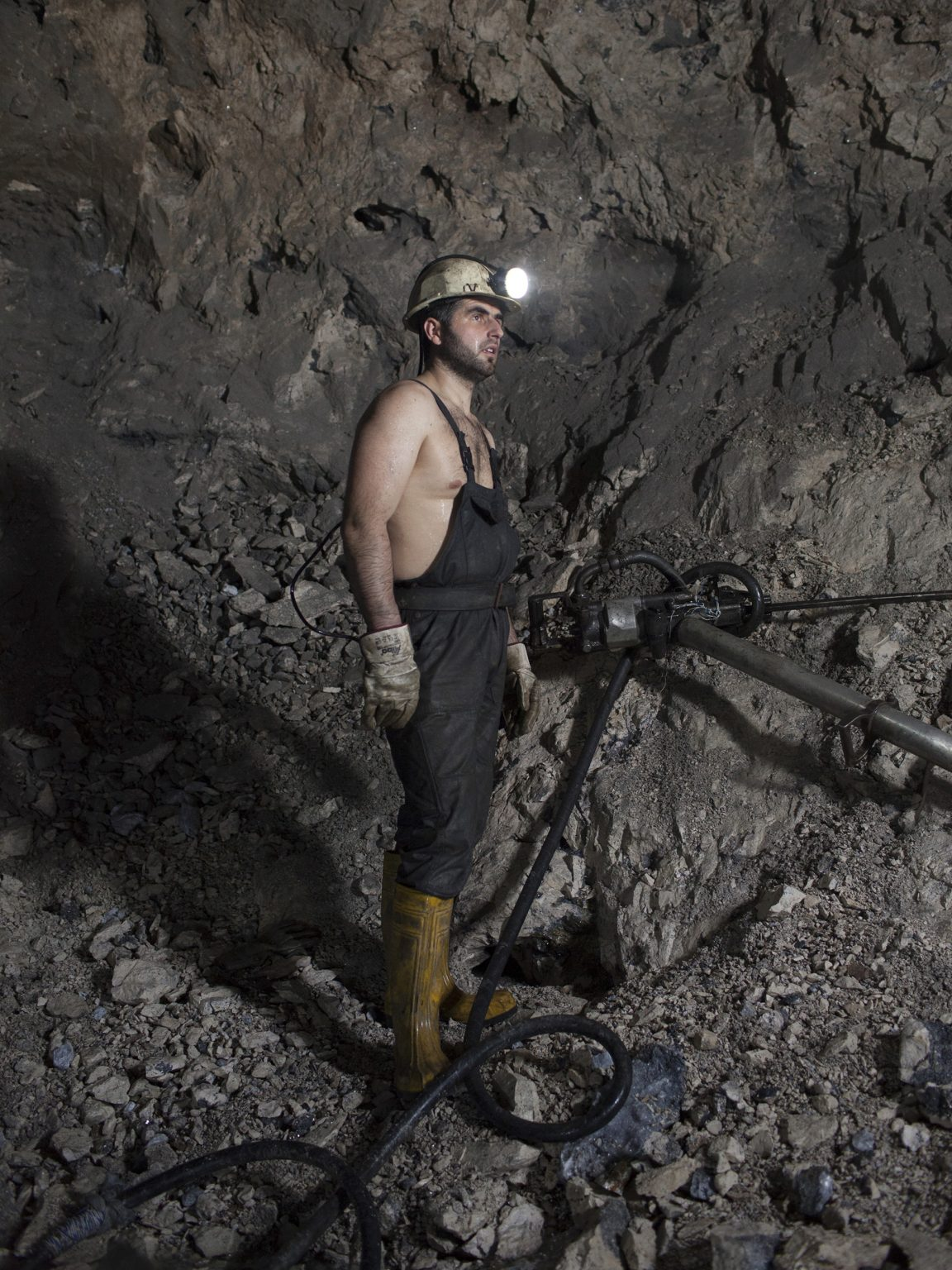 Edmond Selimi, a miner in the Trepca mining complex, portrayed 600 meters below surface.  The Trepca mine is disputed between Serbia and Kosovo.