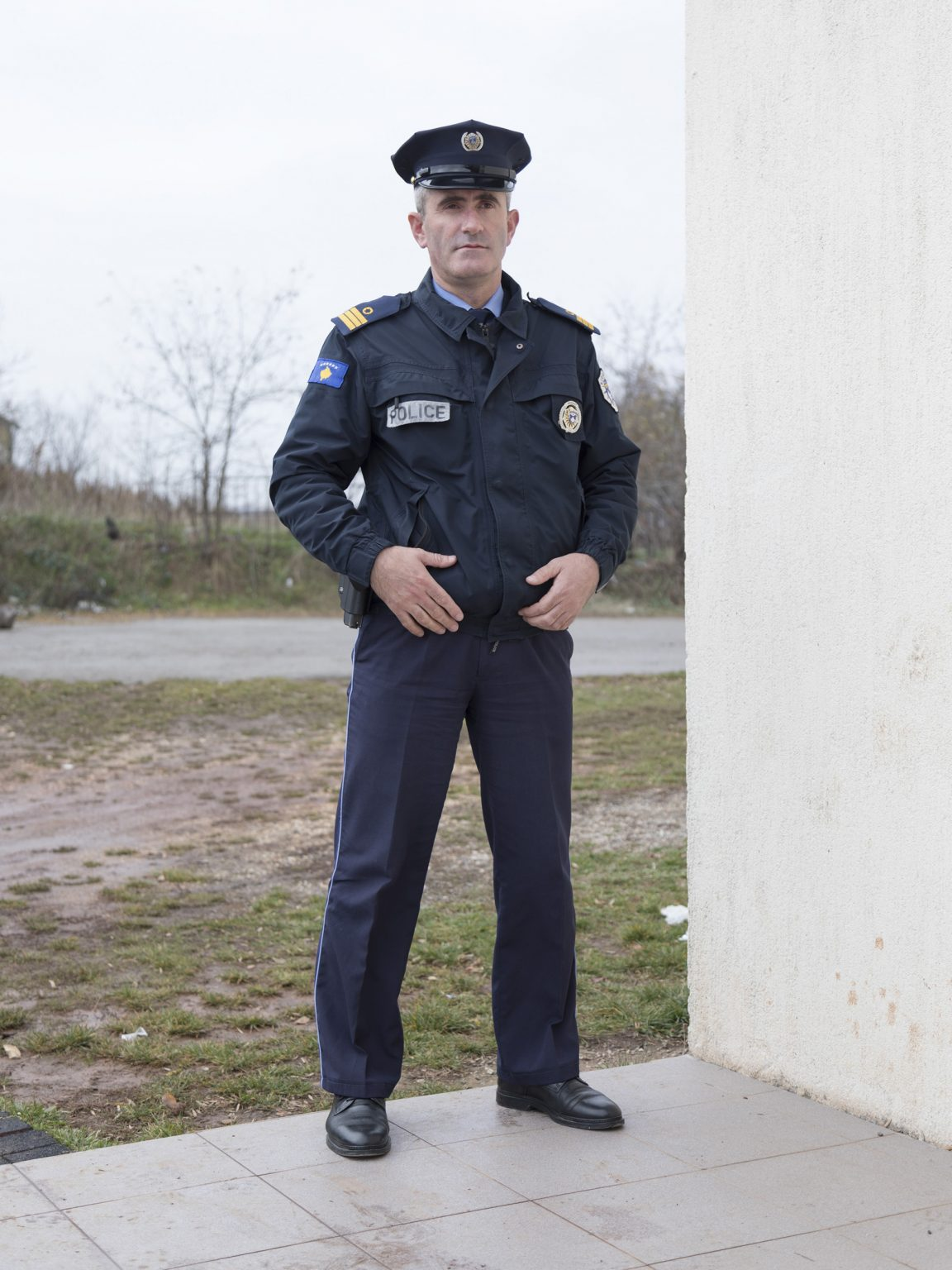 Shukri Xhema, police officer, guards the village school of Palaj/Vodica during the voting process for the Obiliq/Obilić mayor.