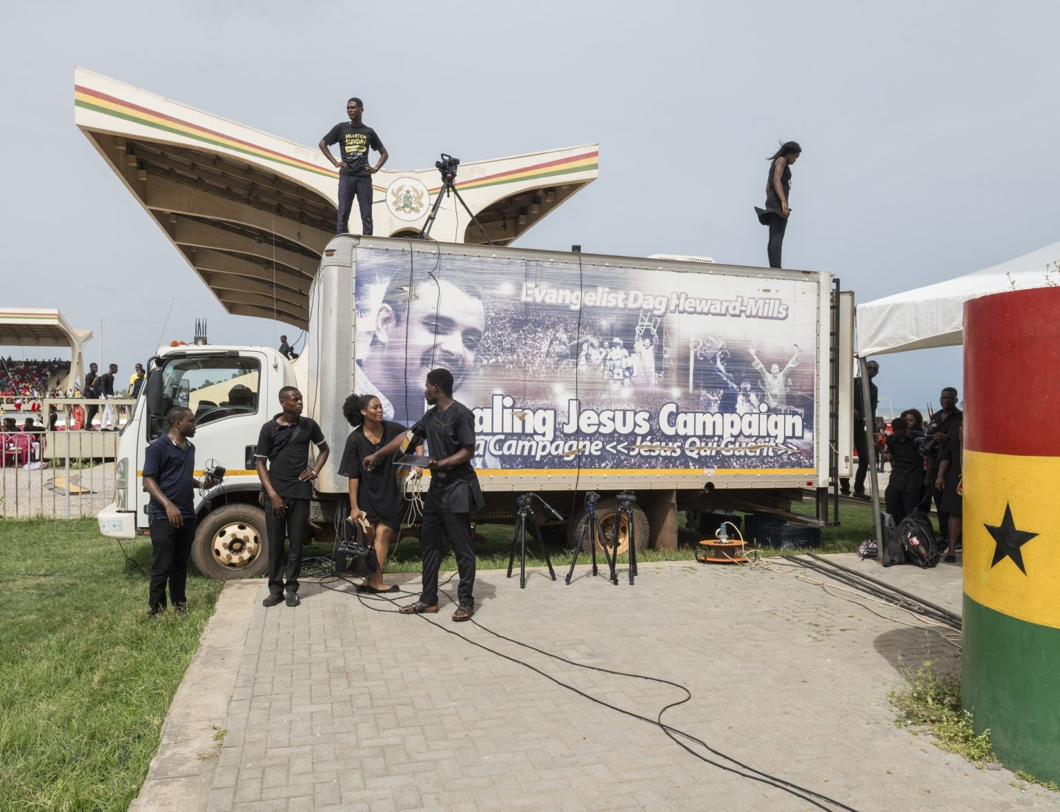 """Accra, Republic of Ghana, April 2019 -Media team during the annual Easter event titled """"Good Friday Miracle Service"""" held in Indipendence Square by Dag Heward-Mills.  Lighthouse Chapel International(LCI), founded in 1988 byDag Heward-Millsand headquartered inAccra it is considered to be one of the leading charismatic churches inGhana, and has over 3000 branches in over 50 countries inAfrica,Europe,Asia, theCaribbean,Australia, theMiddle Eastand theAmericas.><  Accra, Repubblica del Ghana, aprile 2019 - Media team durante l'evento annuale """"Good Friday Miracle Service"""" tenuto da Dag Heward Mills presso Indipendence Square. Lighthouse Chapel International (LCI), fondata nel 1988 da Dag Heward-Mills e con sede ad Accra, è considerata una delle principali chiese carismatiche del Ghana e conta oltre 3000 filiali in oltre 50 paesi in Africa, Europa, Asia, i Caraibi, l'Australia, il Medio Oriente e le Americhe."""