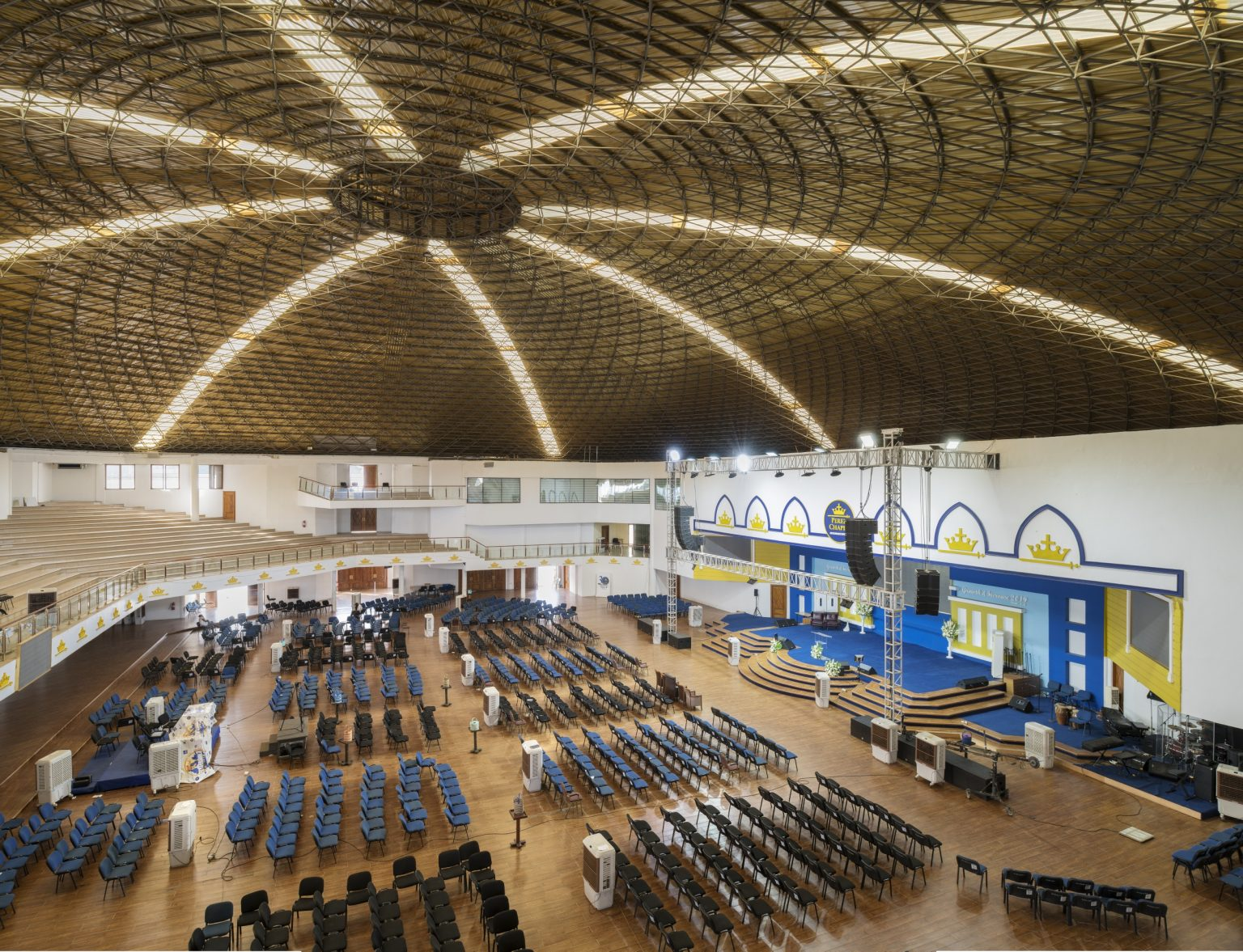 Accra, Republic of Ghana, May 2019 - Interior view of Perez Dome, the main auditorium and headquarter of Perez Chapel International located in in Dzorwulu and considered among the largest auditoriums in the country. Perez Chapel International, formerly known as the Word Miracle Church International is an evangelical, Charismatic church founded in Tamale, Northern Ghana in 1987 by bishop Charles Agyinasare who is nowadays among the richest pastors in Ghana. With over 400 local branches and several abroad is one of the leading churches of the country. ><                                          Accra, Repubblica del Ghana, maggio 2019 - Una veduta interna del Perez Dome, l'auditorium principale e quartier generale della Perez Chapel International considerato tra gli auditorium maggiori del paese. Perez Chapel International, precedentemente nota come Word Miracle Church International è una chiesa evangelica, carismatica fondata a Tamale, nel Ghana Settentrionale nel 1987 dal vescovo Charles Agyinasare, che oggi è tra i più ricchi pastori del Ghana. Con oltre 400 filiali locali e diverse altre all'estero è una delle principali chiese del paese.